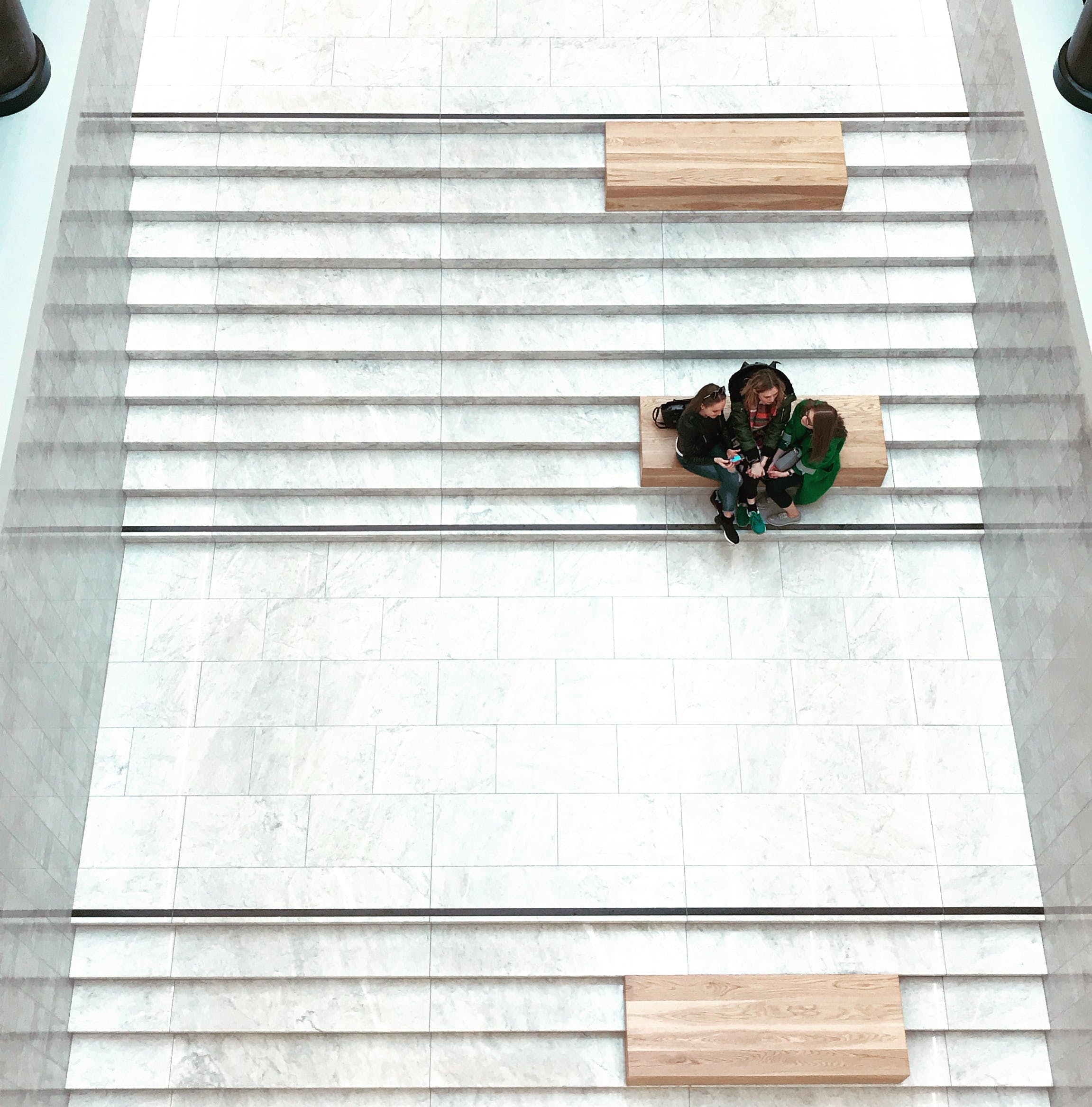 Aerial View of Women Sitting on Bench