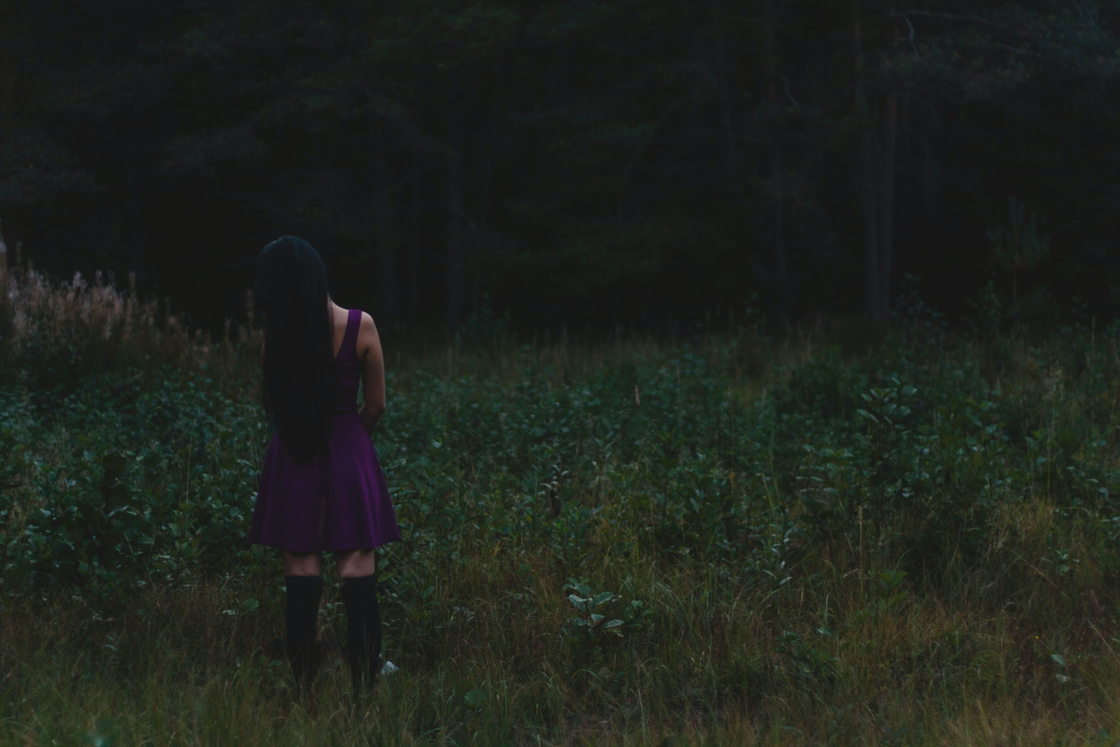 Photo of Woman Standing on Grass Field