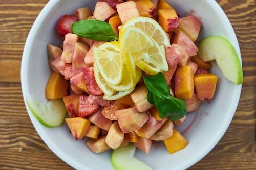 Sliced Fruits In White Bowl