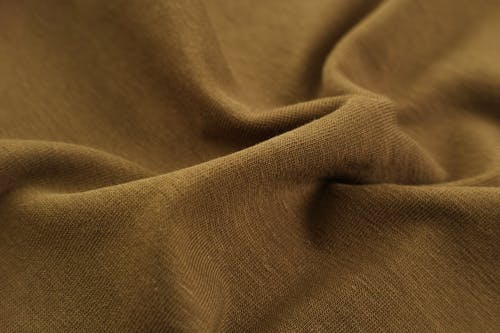 Close-Up Photo of Brown Textile