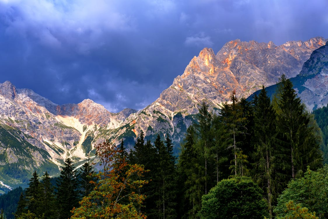 Mountain And Trees Under Cloudy Sky
