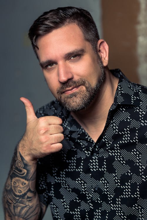 Free stock photo of man, tattoo, thumbs up