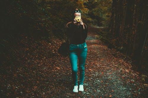 Woman Holding Yellow Camera