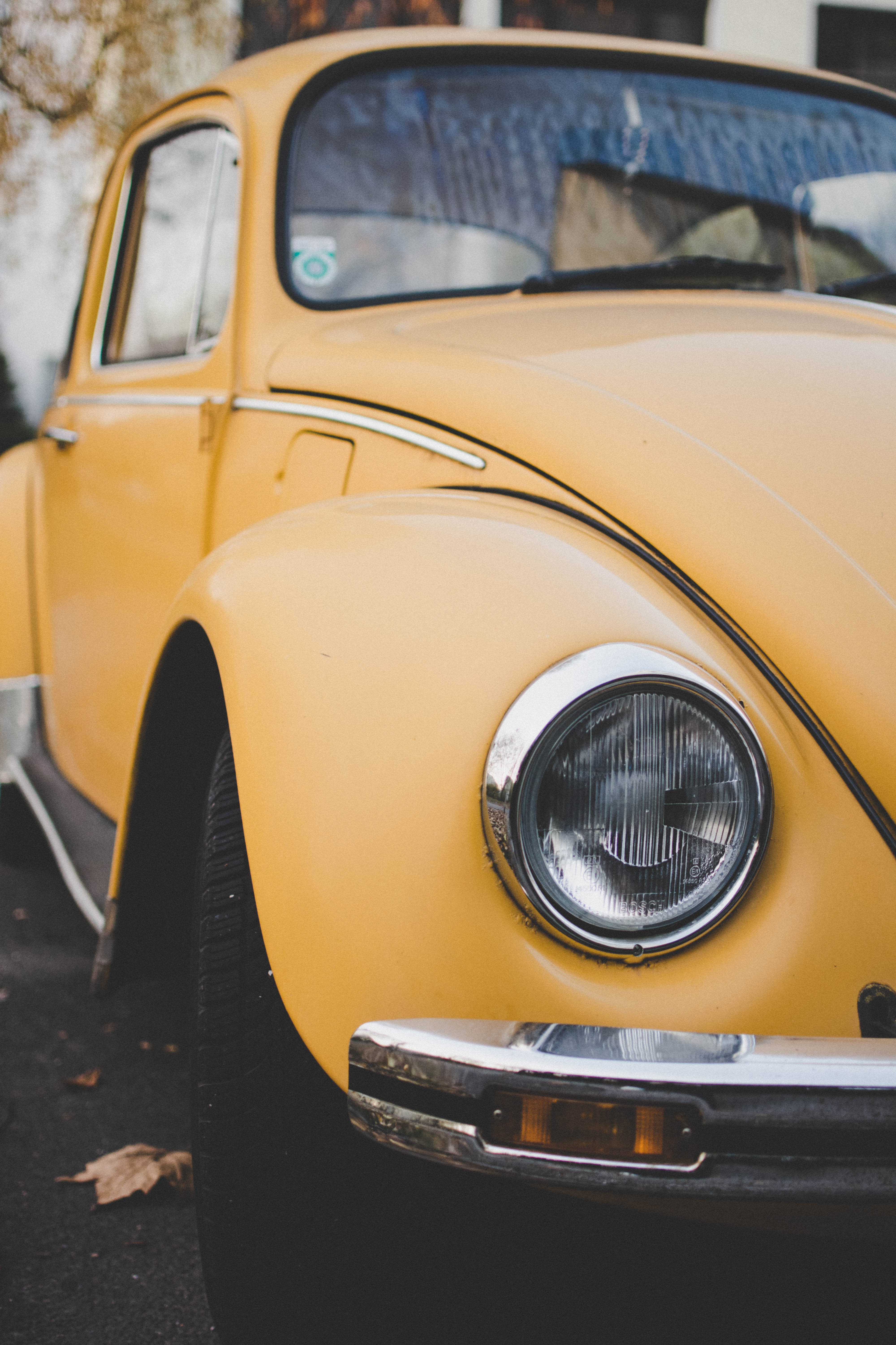 Yellow Volkswagen Beetle Coupe Parked on Gray Concrete Surface