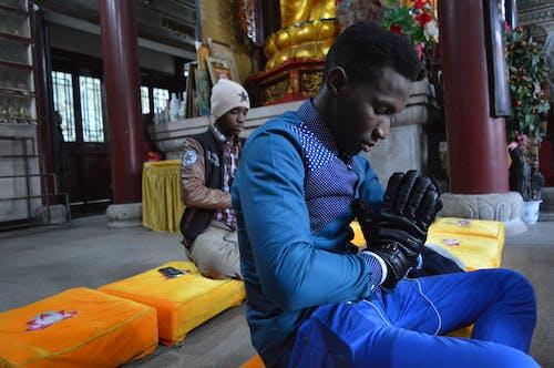 Two Sitting Man Praying Inside Building