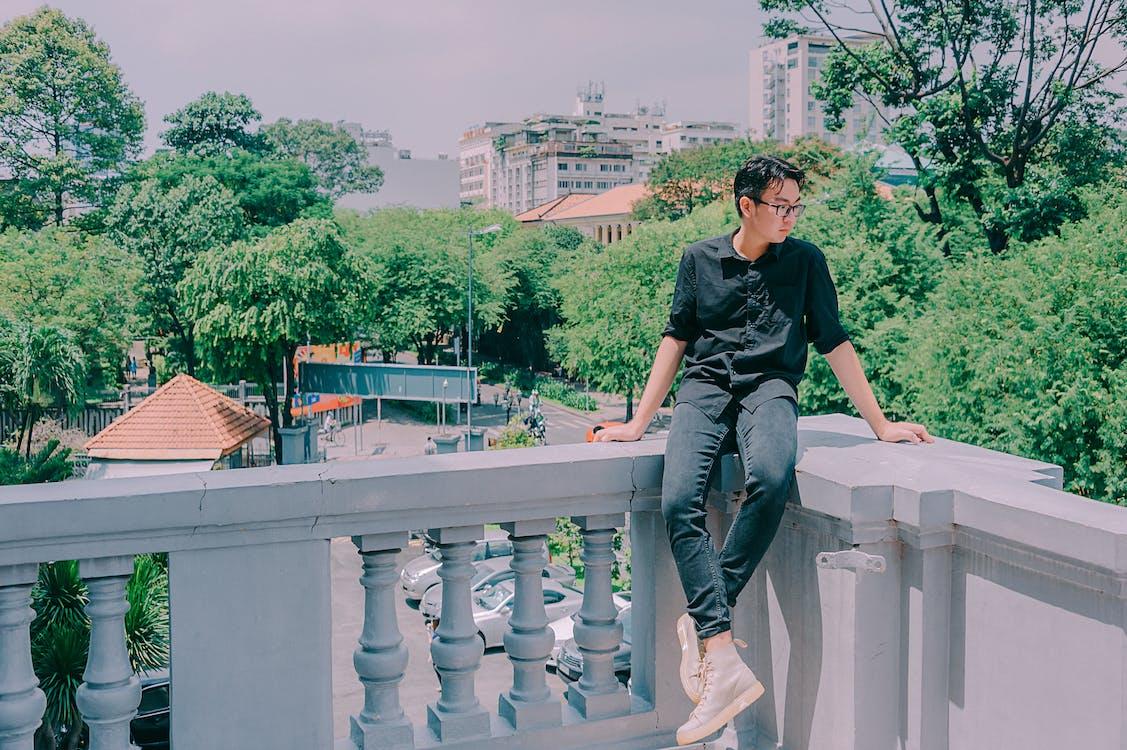 Man Sitting On Veranda · Free Stock Photo