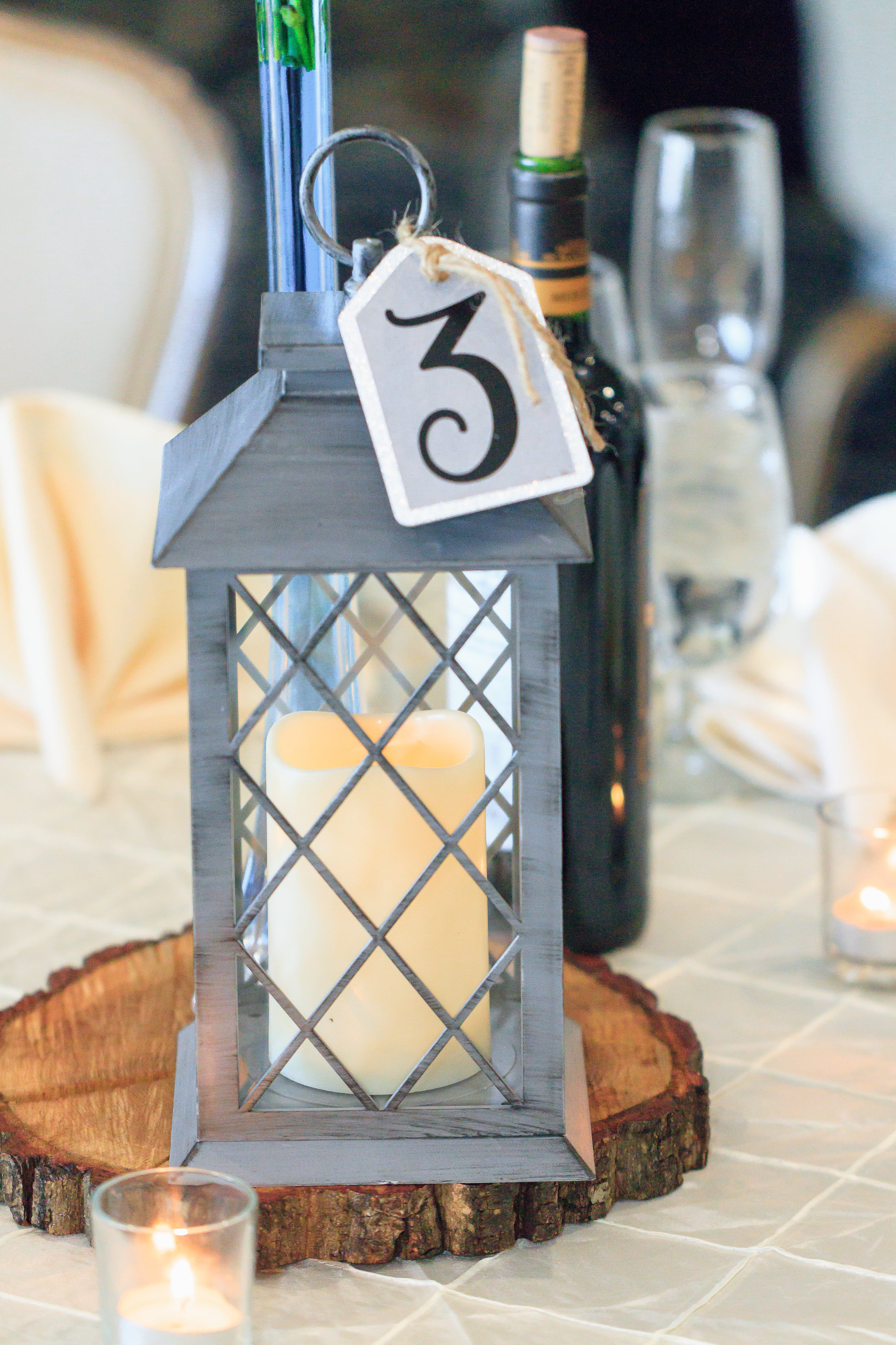 Selective Focus Photography of Candle Lantern on Table