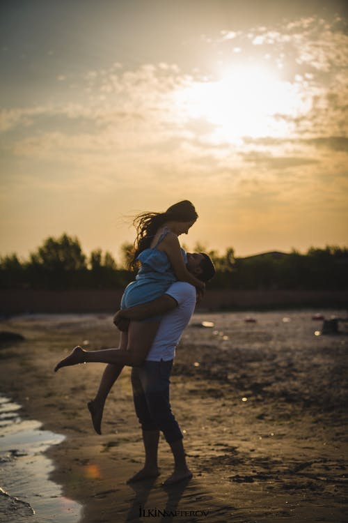 Hugging Couple Beside Seashore
