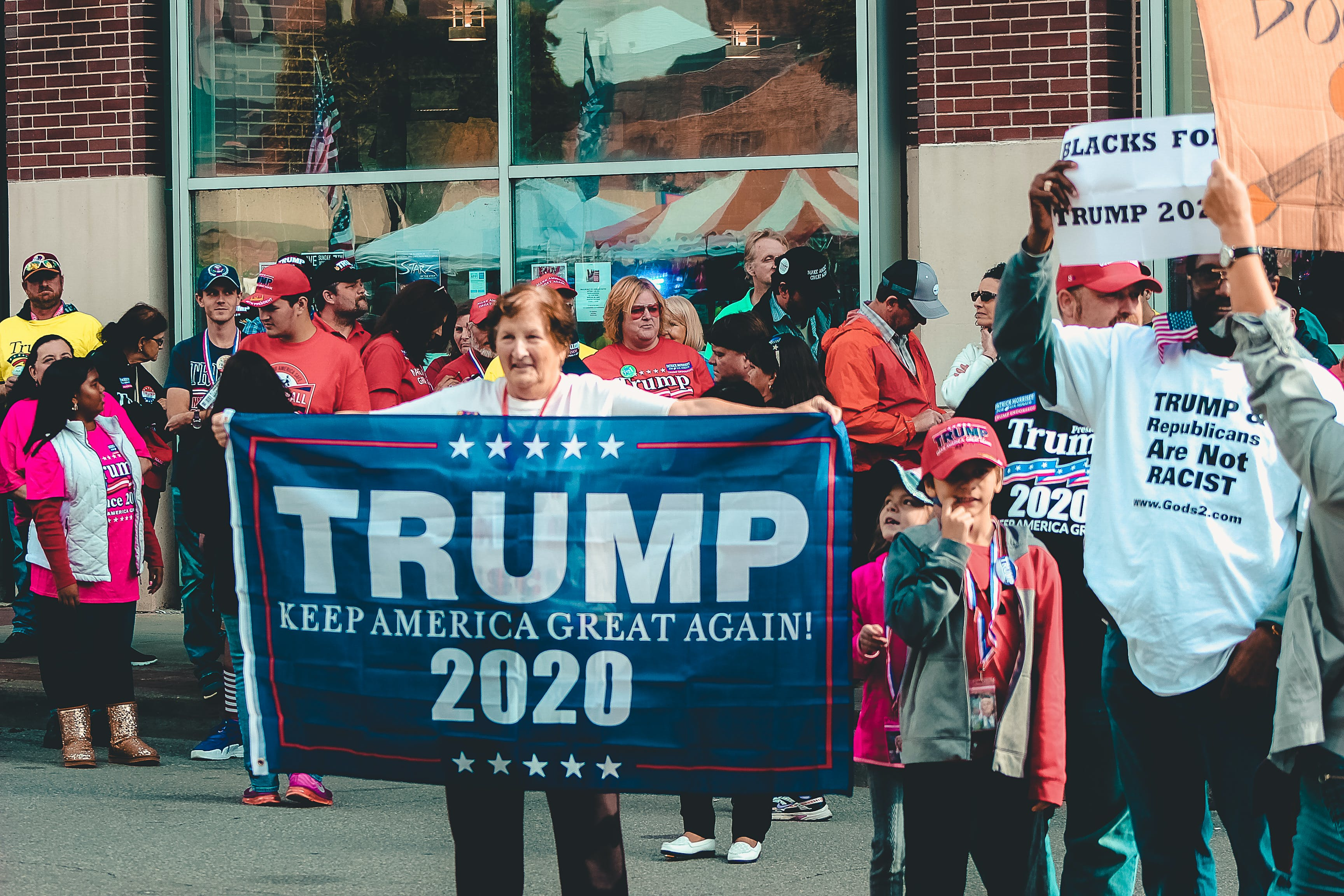 Woman Holding Trump Keep America Great Again 2020 Banner