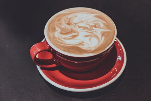 Cafe Latte in Round Red Cup and Saucer