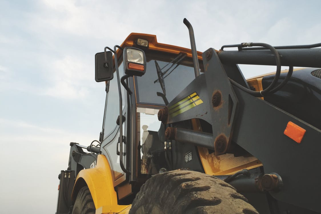 Yellow and Black Heavy Equipment Under Blue Sky