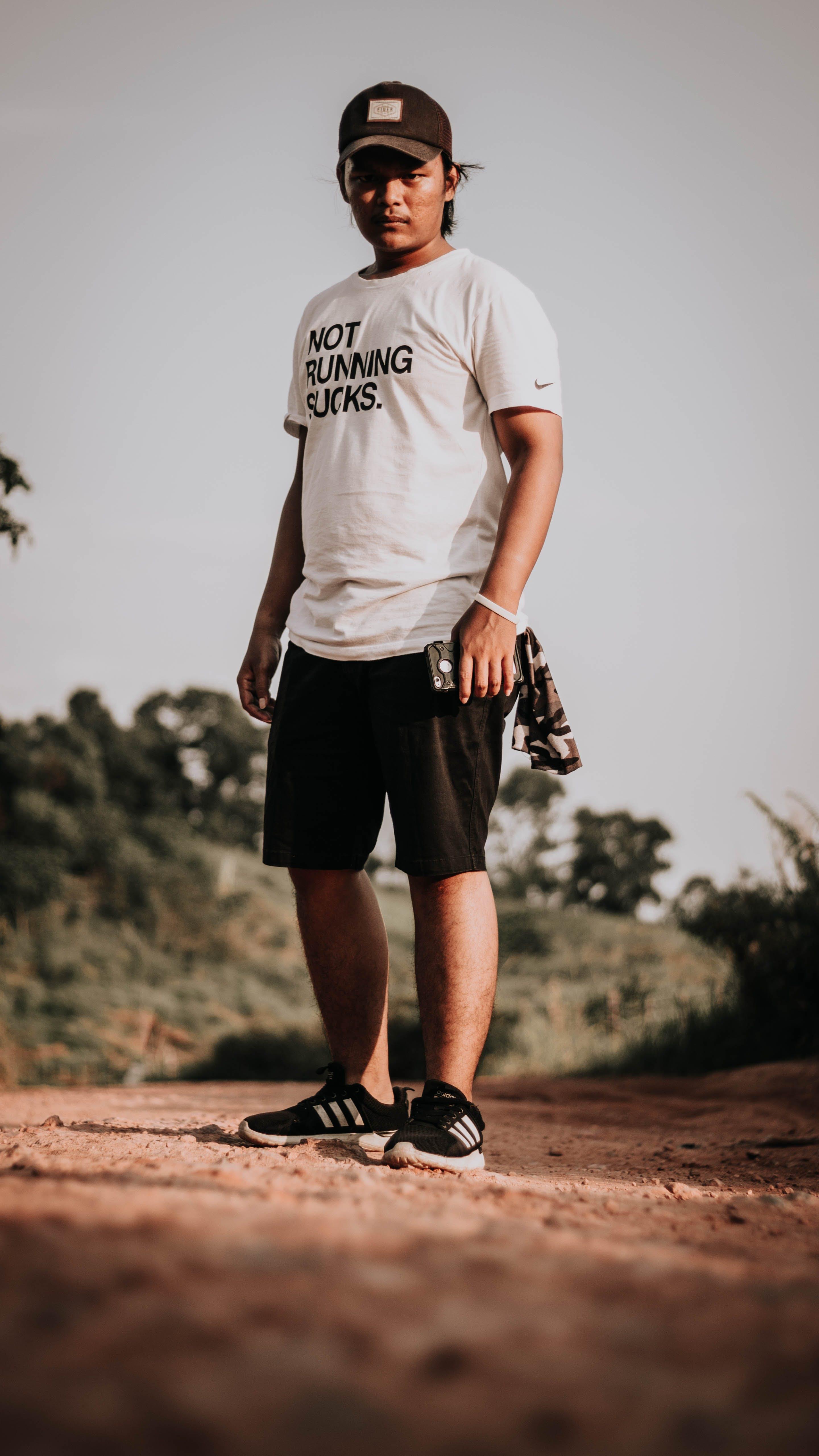 Man Standing on Pathway