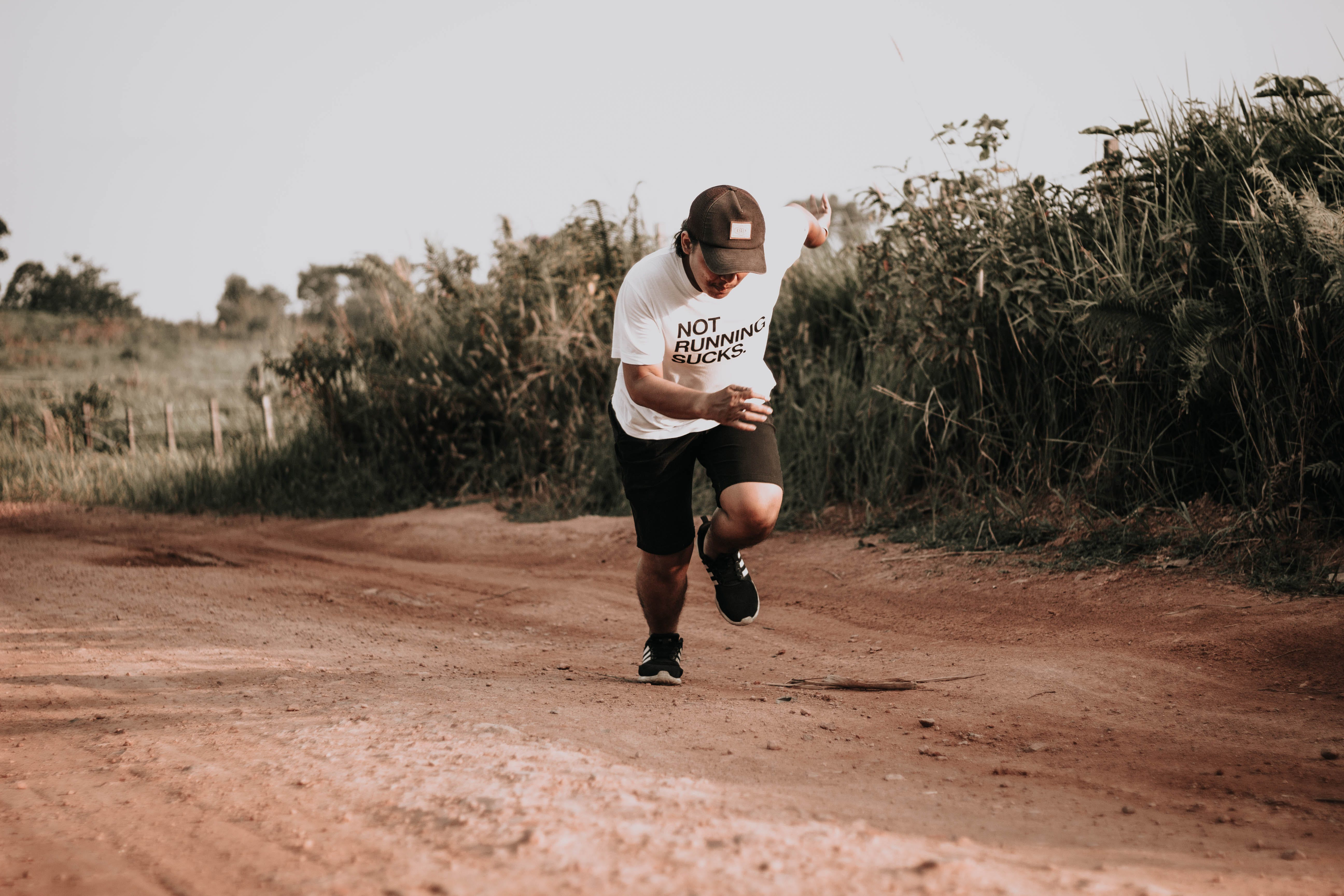 Man Running on Dirt Road