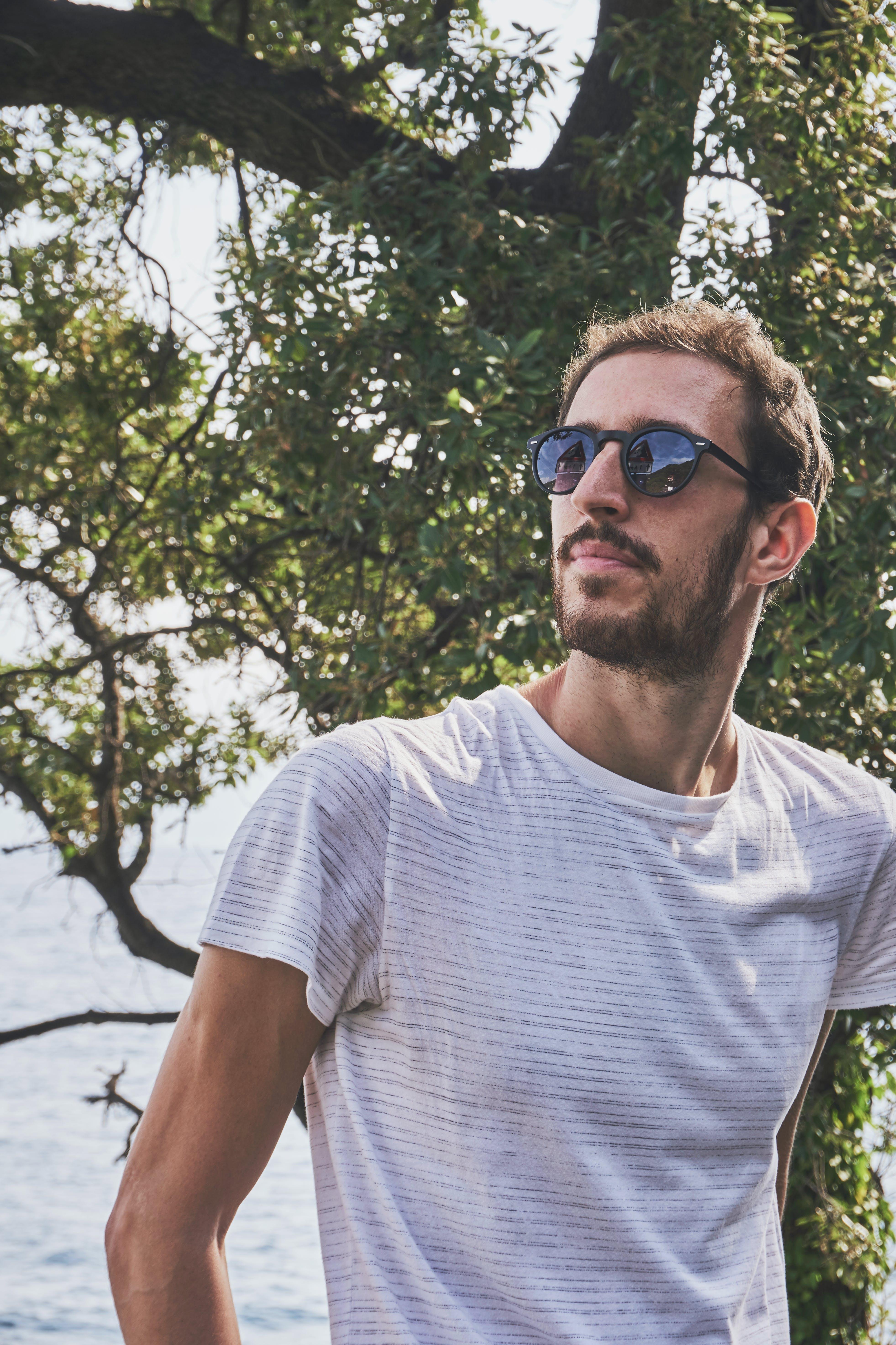 Man Wearing White Crew-neck T-shirt And Sunglasses