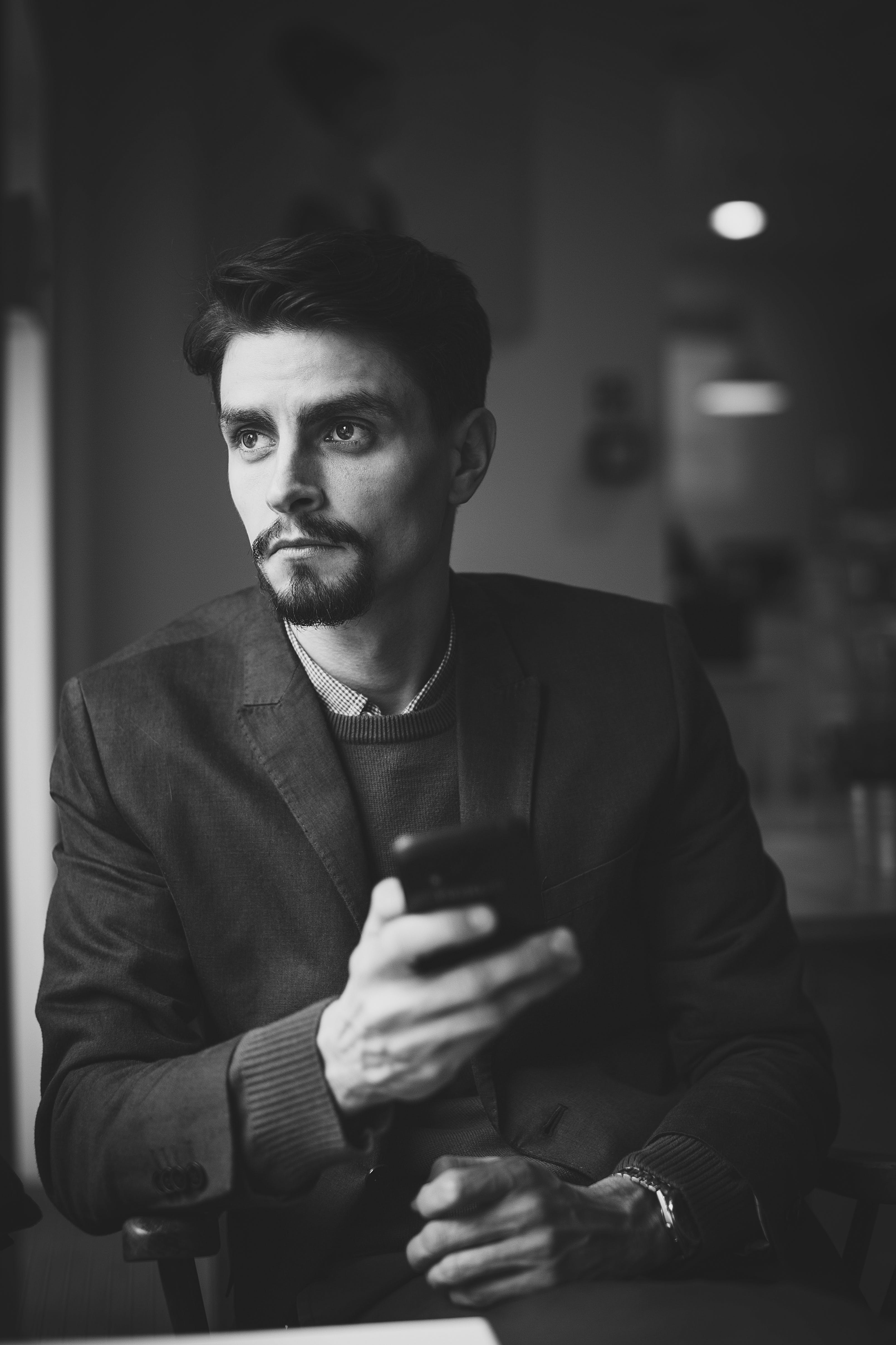 Free stock photo of black-and-white, man, person, smartphone