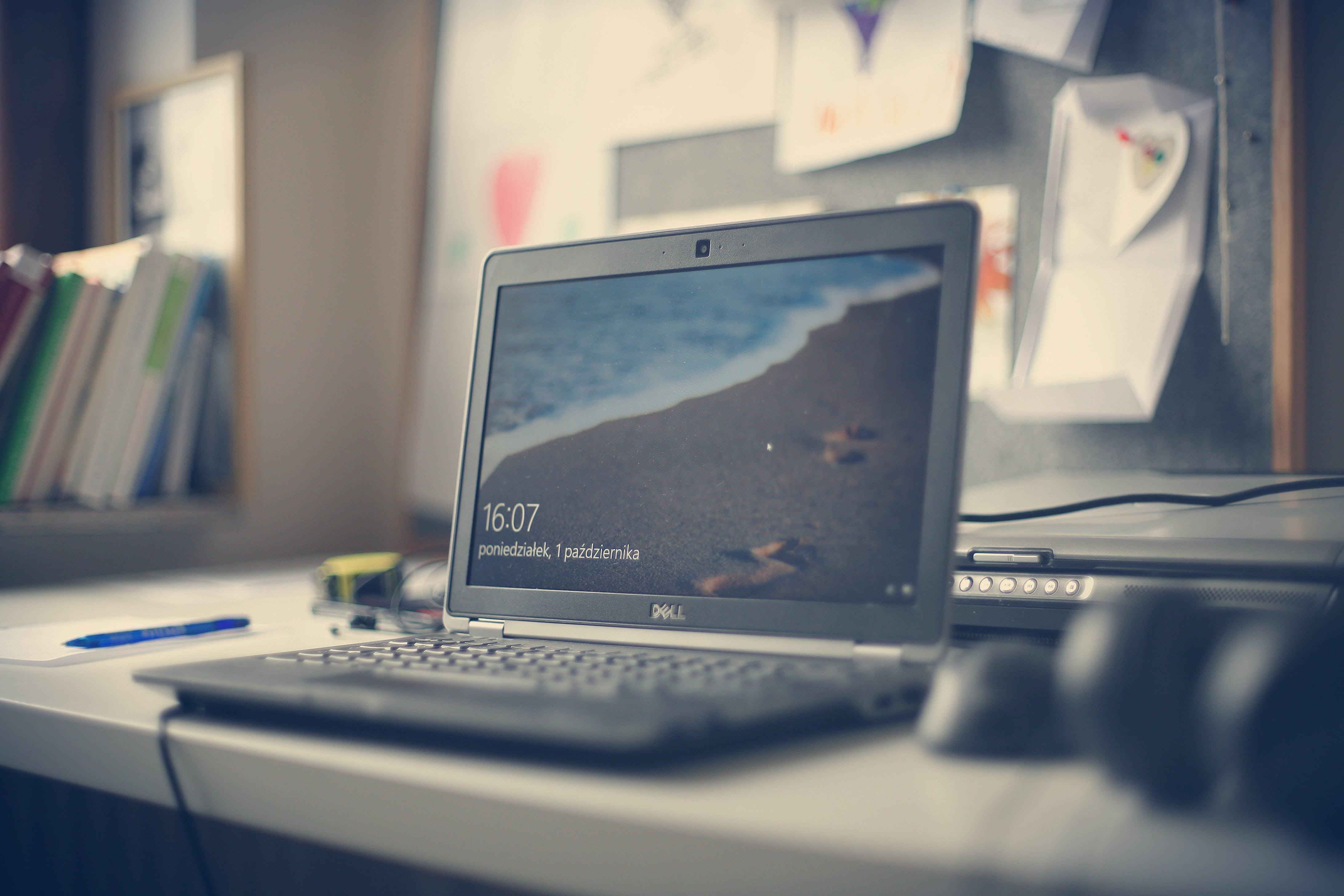 Black Dell Laptop on White Desk