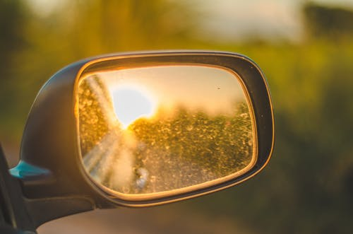 Free stock photo of car mirror, dirty mirror, evening sun, golden sun