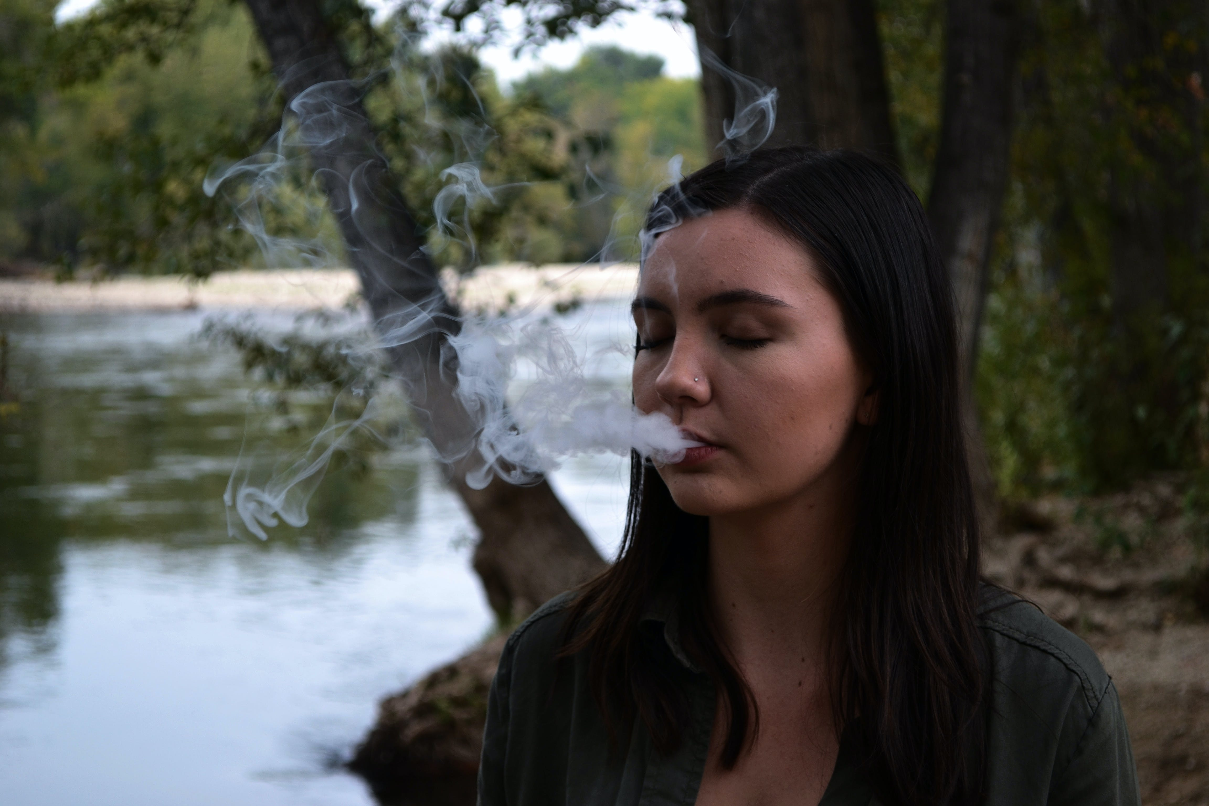Woman With Smoke Coming Out from Mouth
