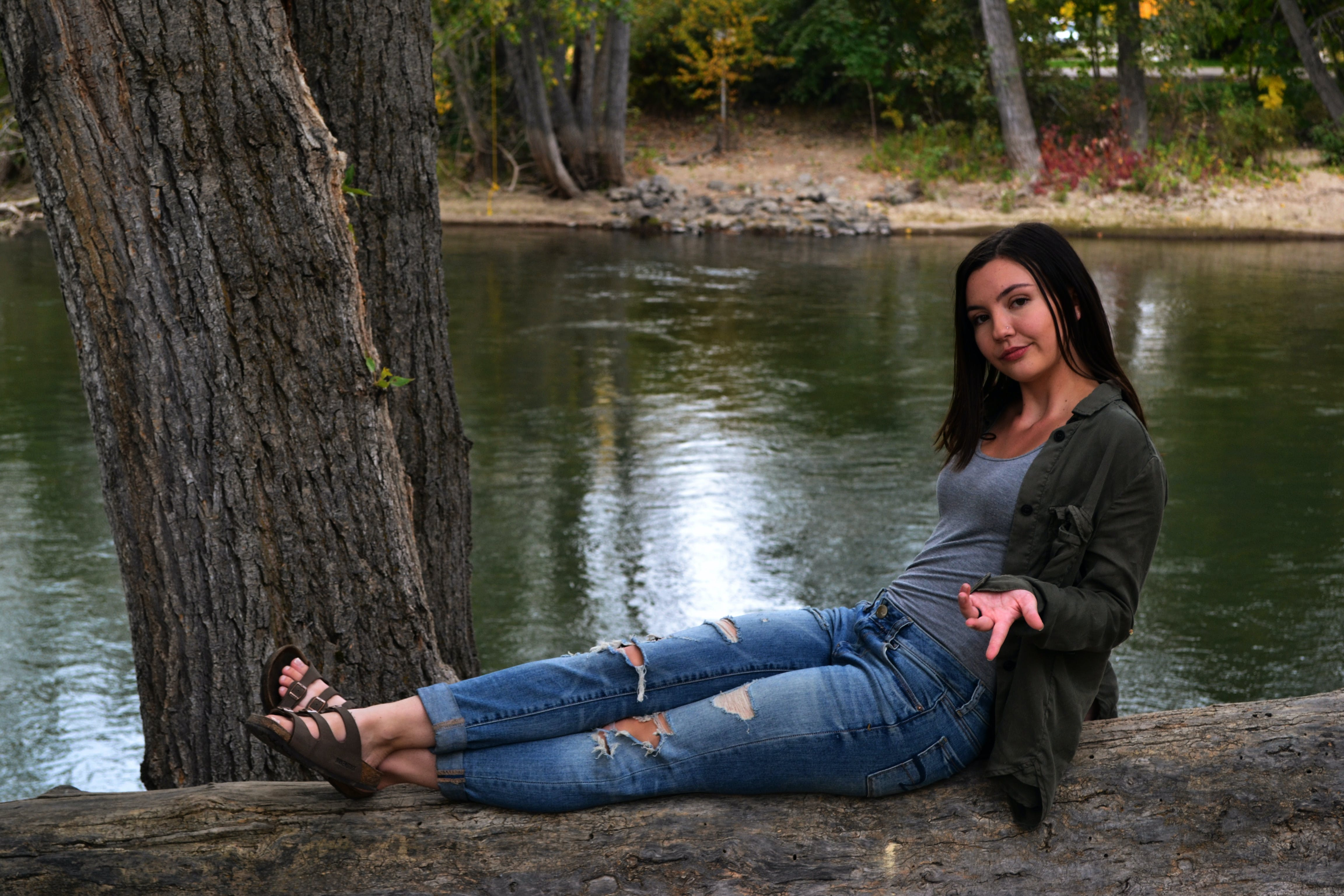 Photo of Woman Sitting On Tree Trunk