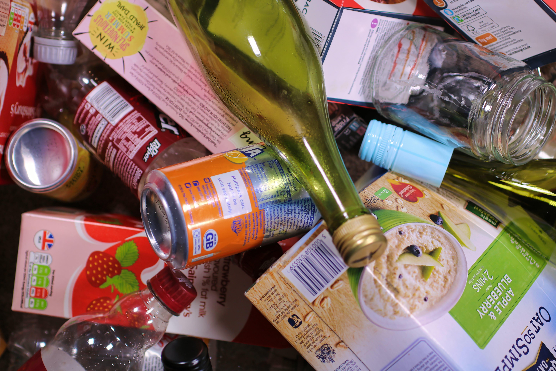 Free stock photo of cardboard, cardboard cartons, garbage, glass bottles