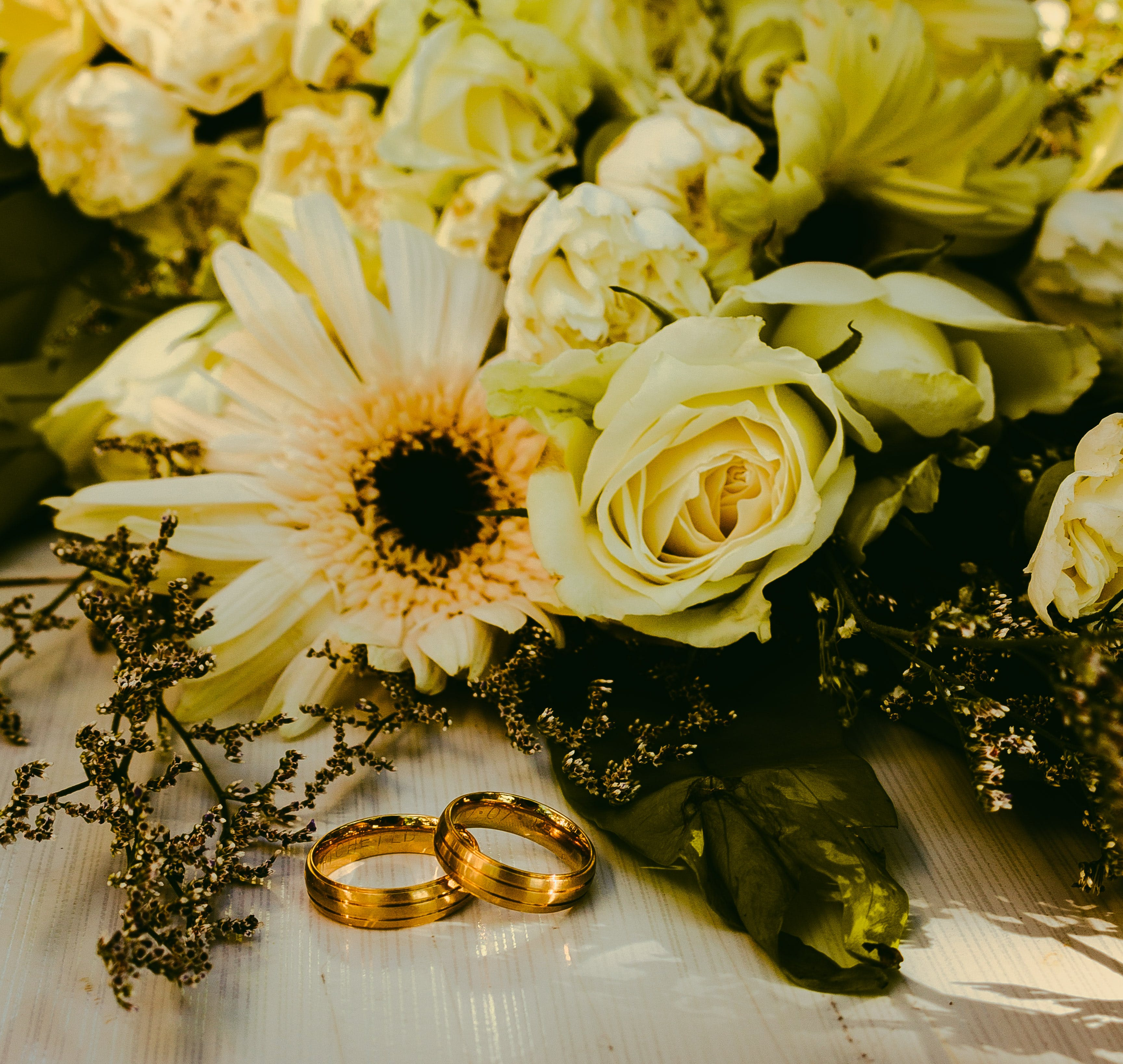 Rings Beside Flower Bouquet