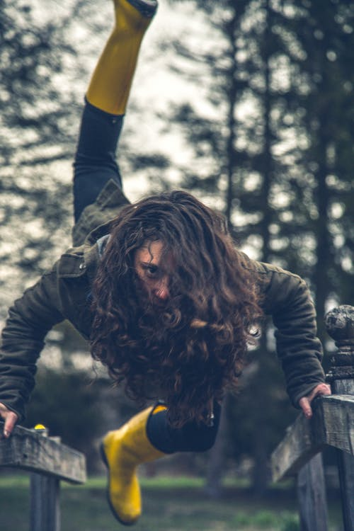 Free stock photo of boots, curly hair, woods