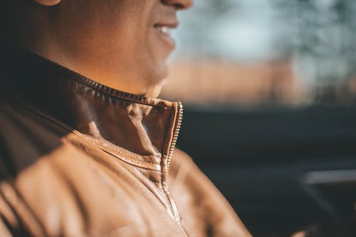 Selective Focus Photo of Man Wearing Brown Jacket