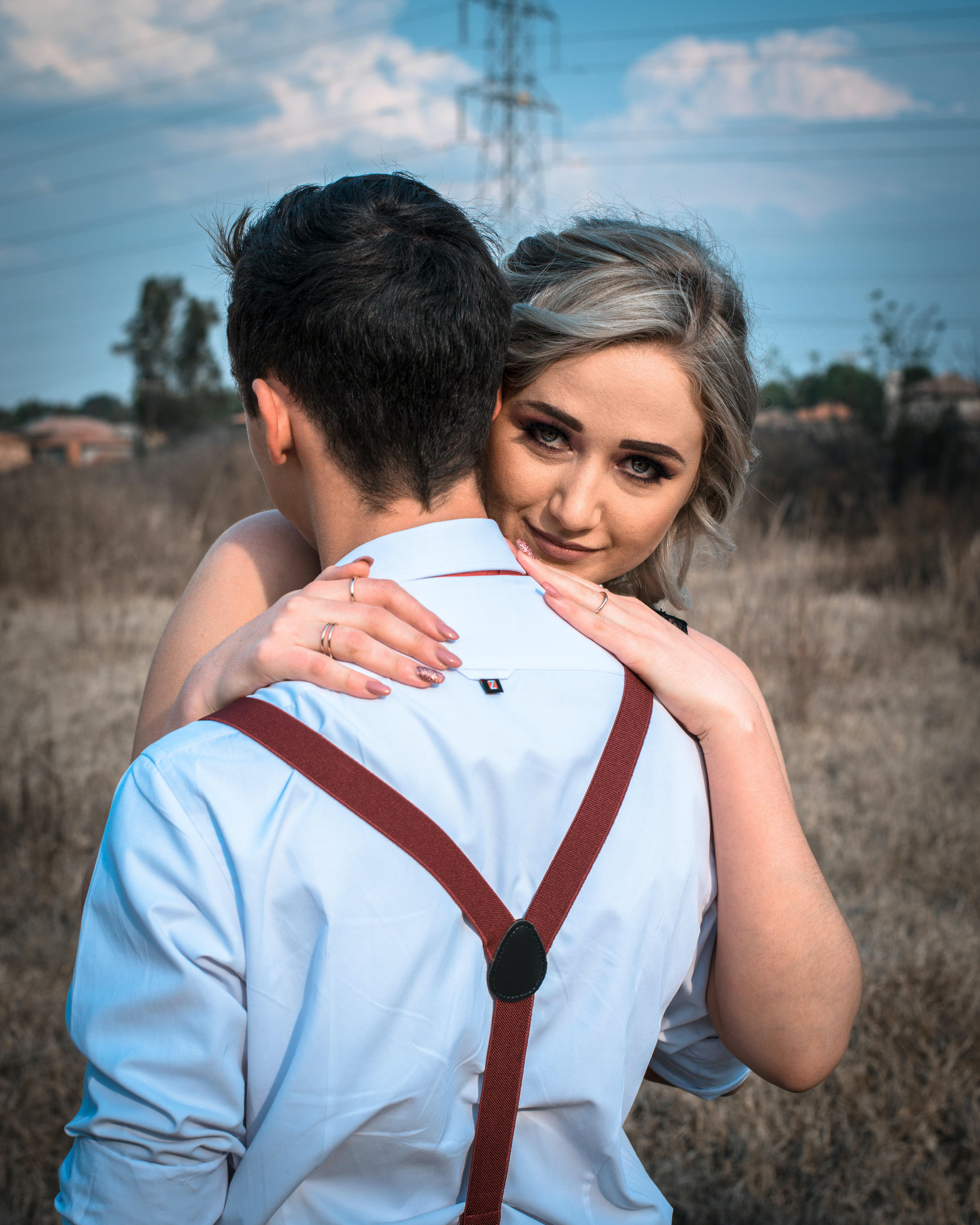 Woman and Man Hugging Each Other