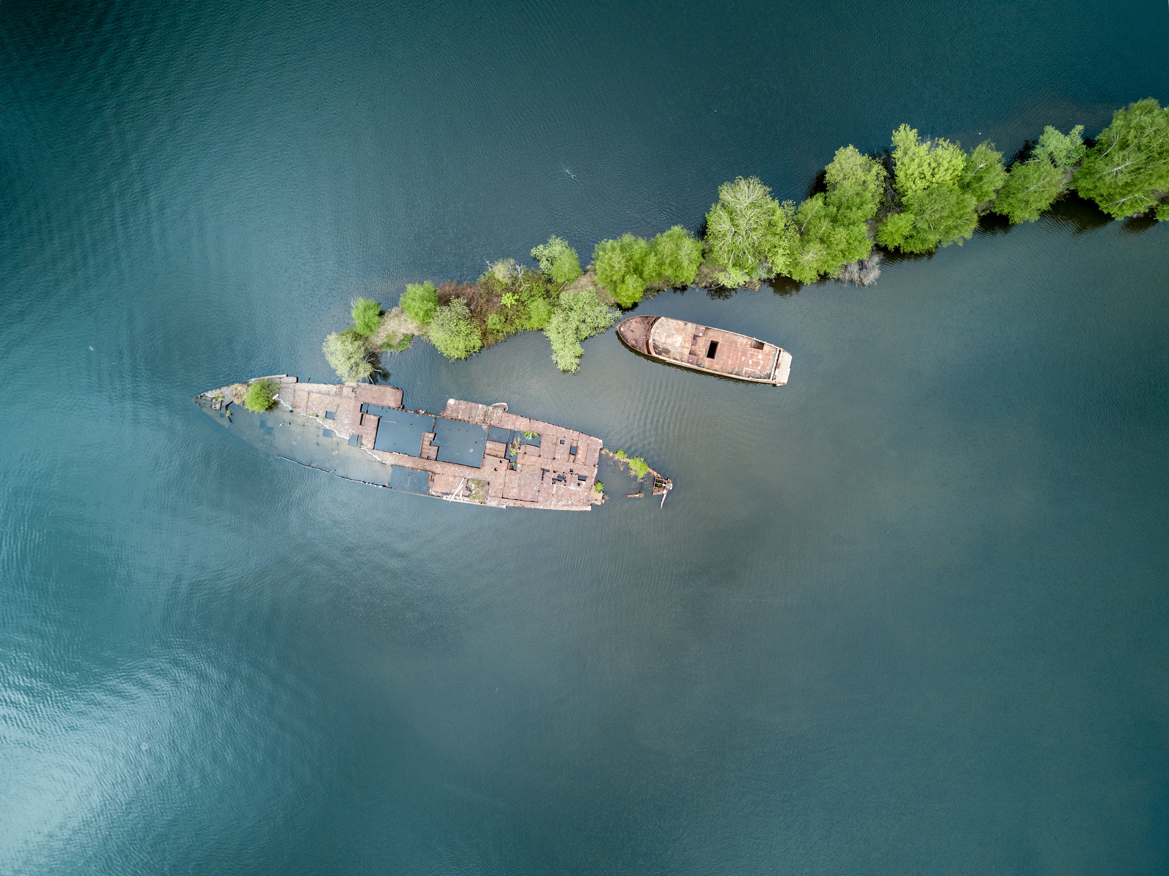 Aerial Photography of Boat and Green Trees on Top of Water