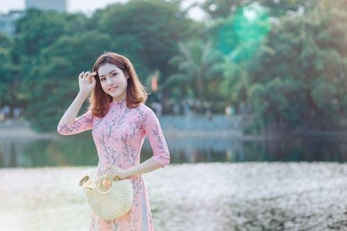 Woman Holding Handbag Near Body of Water