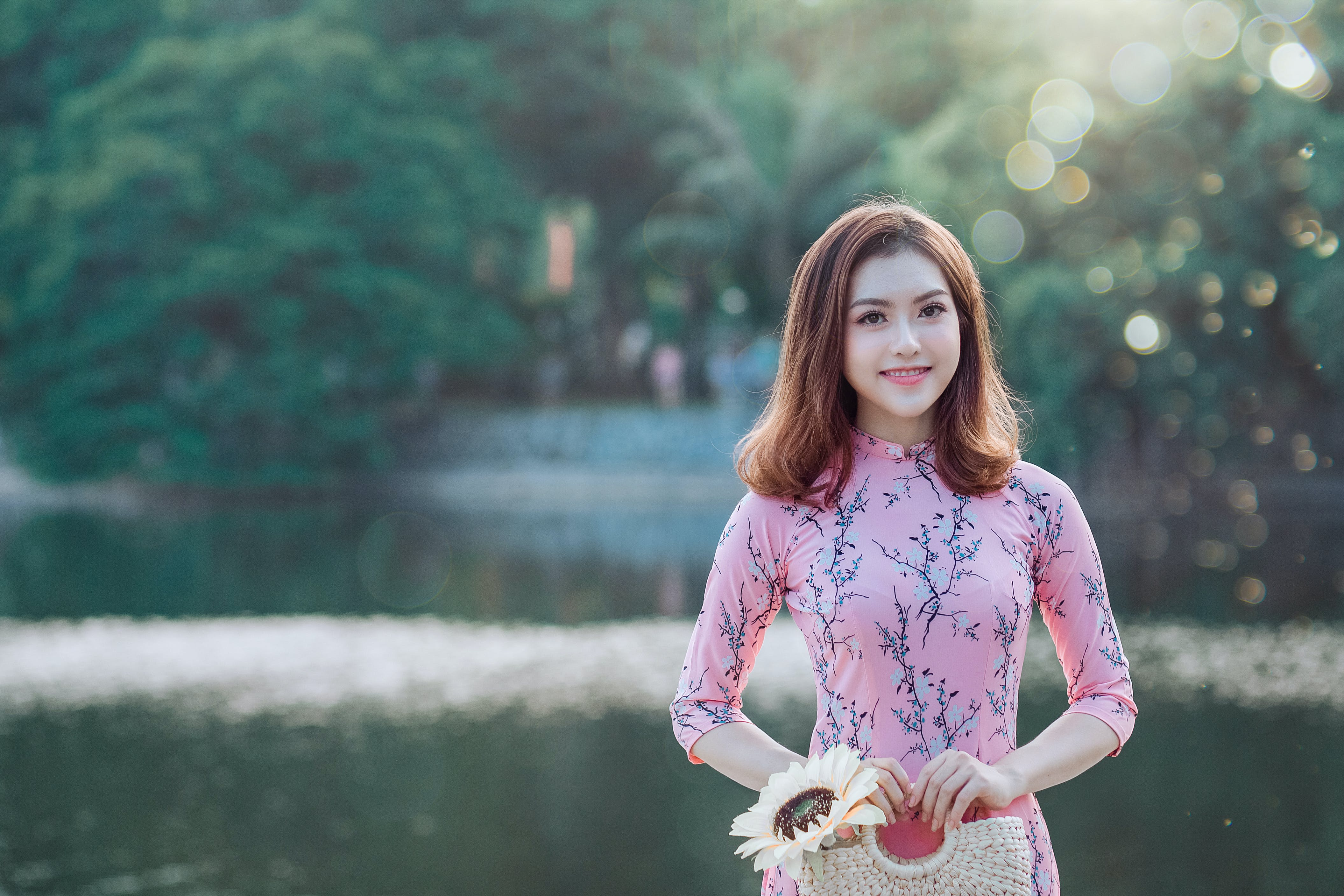 Woman Smiling While Standing Near Body of Water