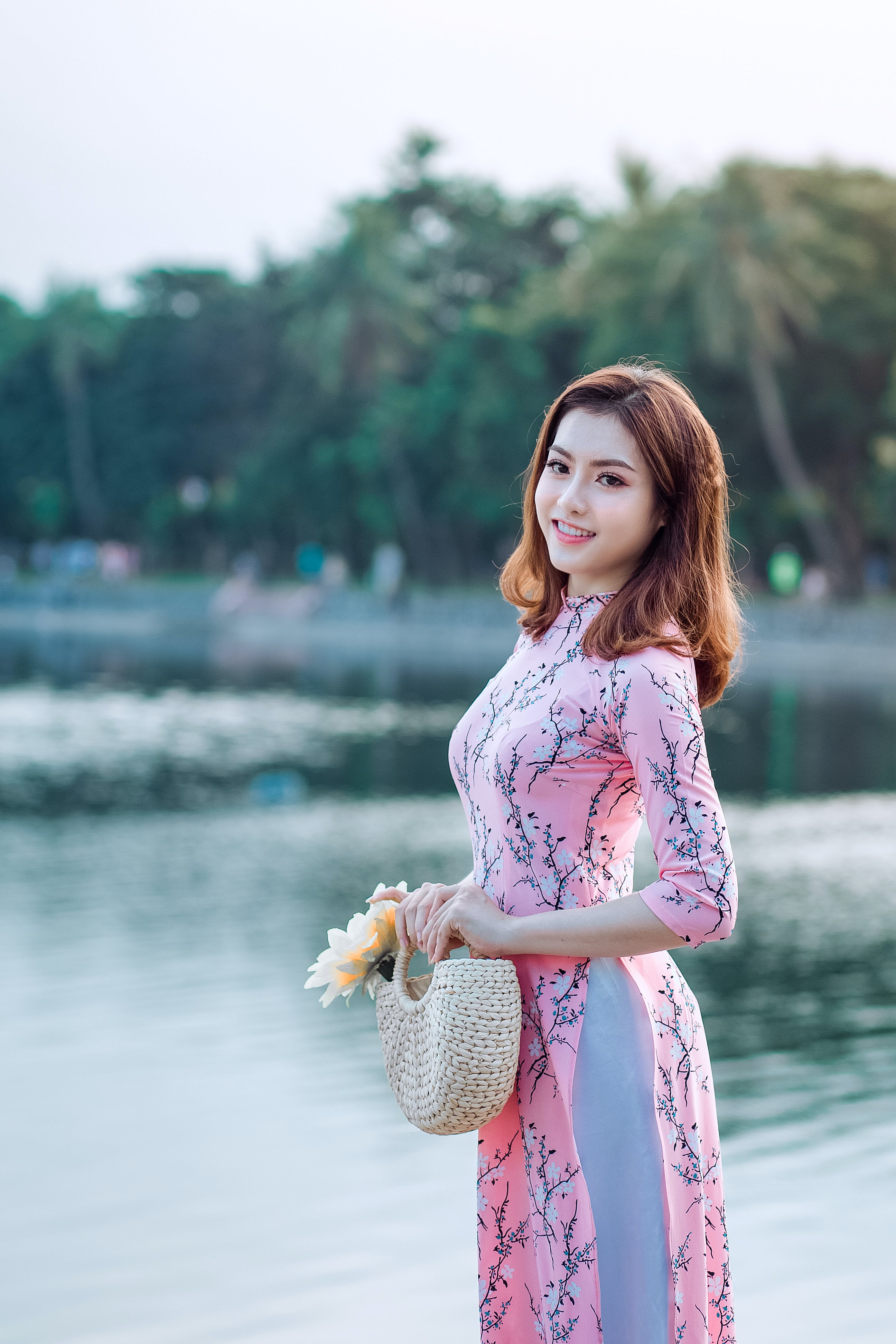 Woman in Pink and Blue Floral 3/4-sleeved Dress