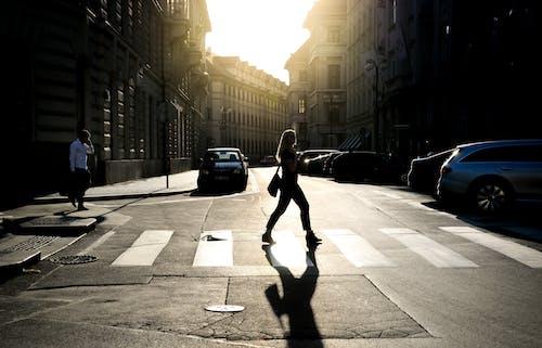 Woman Walking on Pedestrian Lane