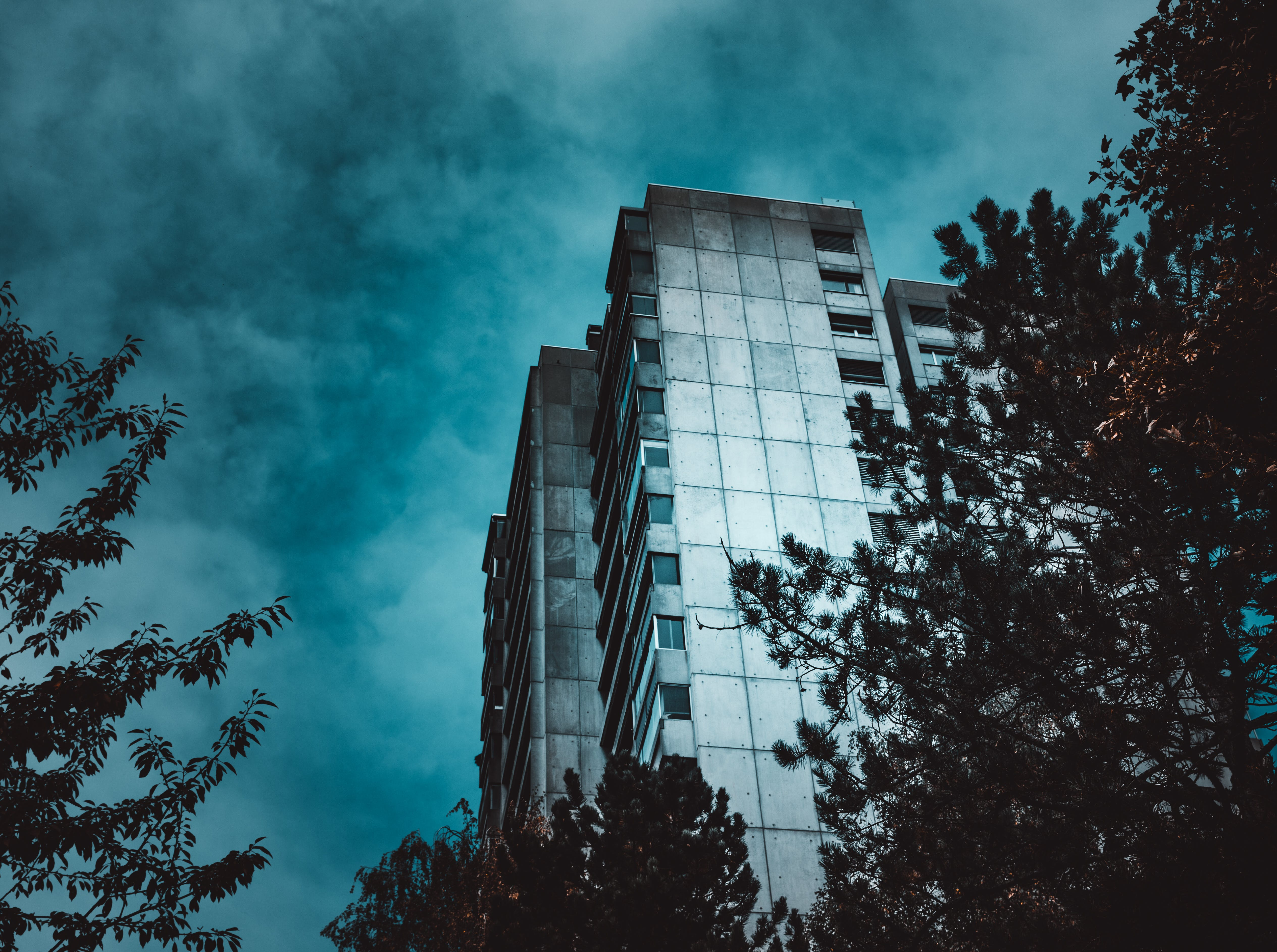 Low-angle Photography of White and Gray High-rise Building