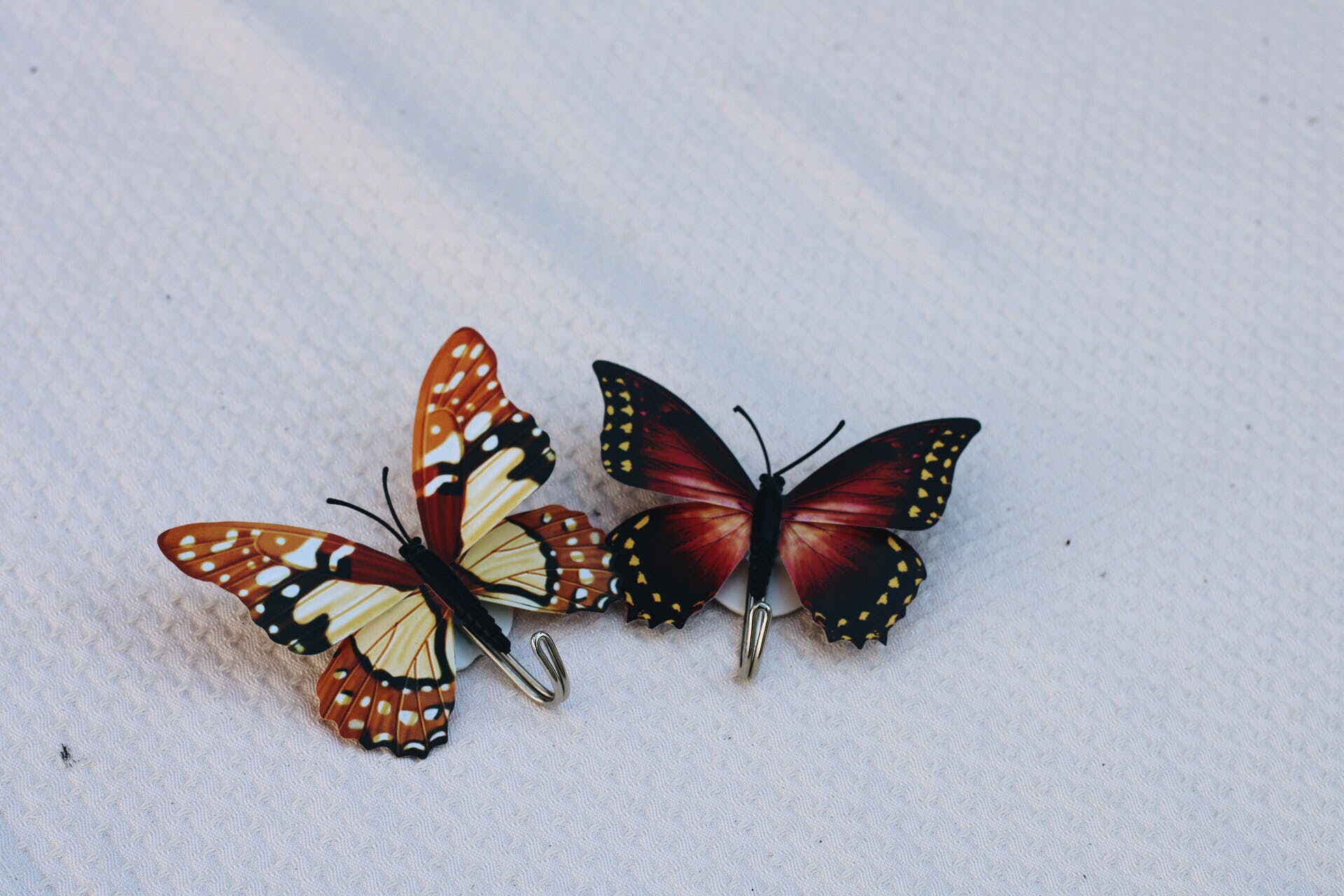 Brown and Black Butterfly Shower Curtain Hooks on White Linen
