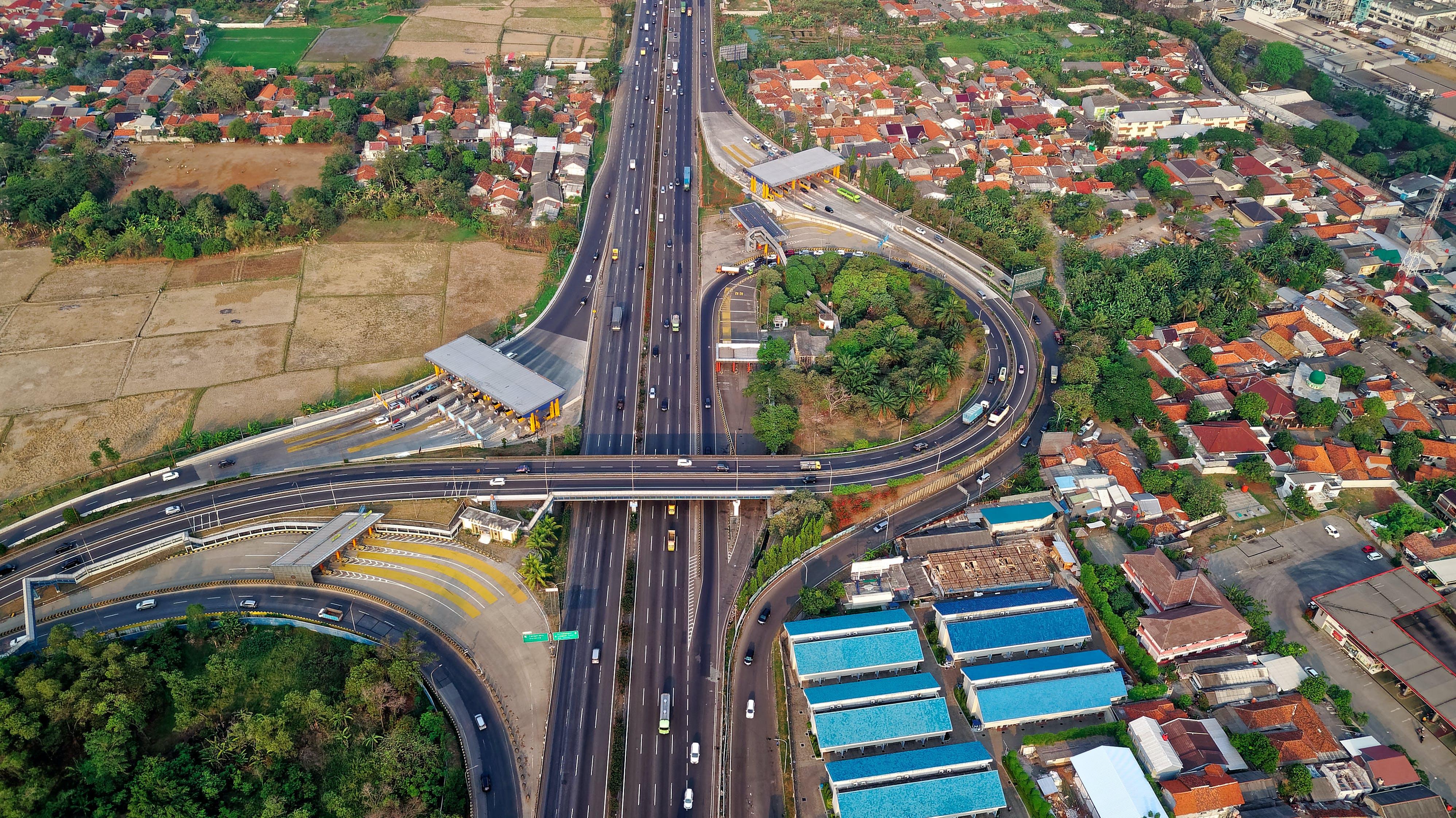 Free stock photo of aerial, bridge, buildings, cars