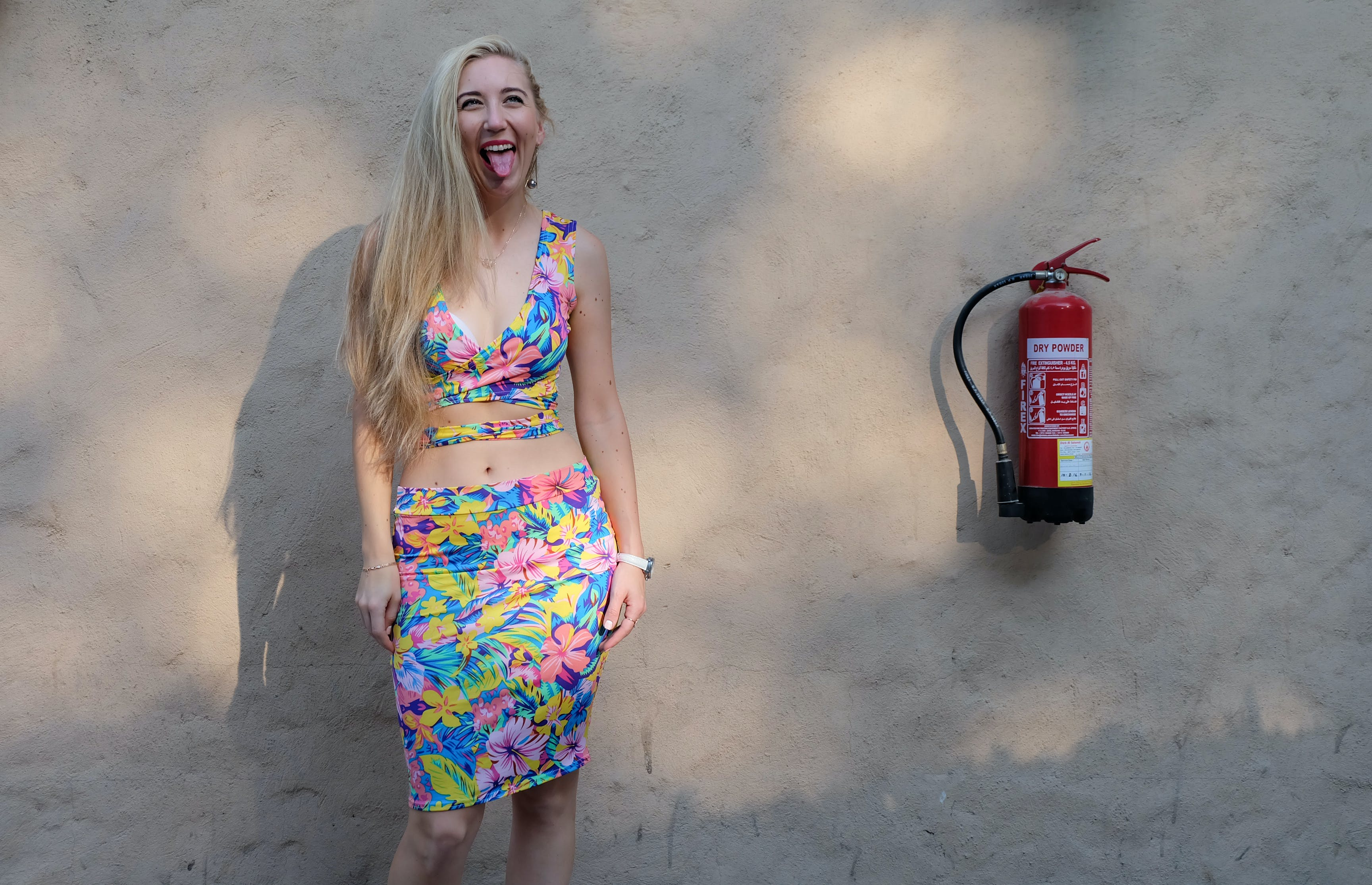 Woman Standing Near Fire Extinguisher