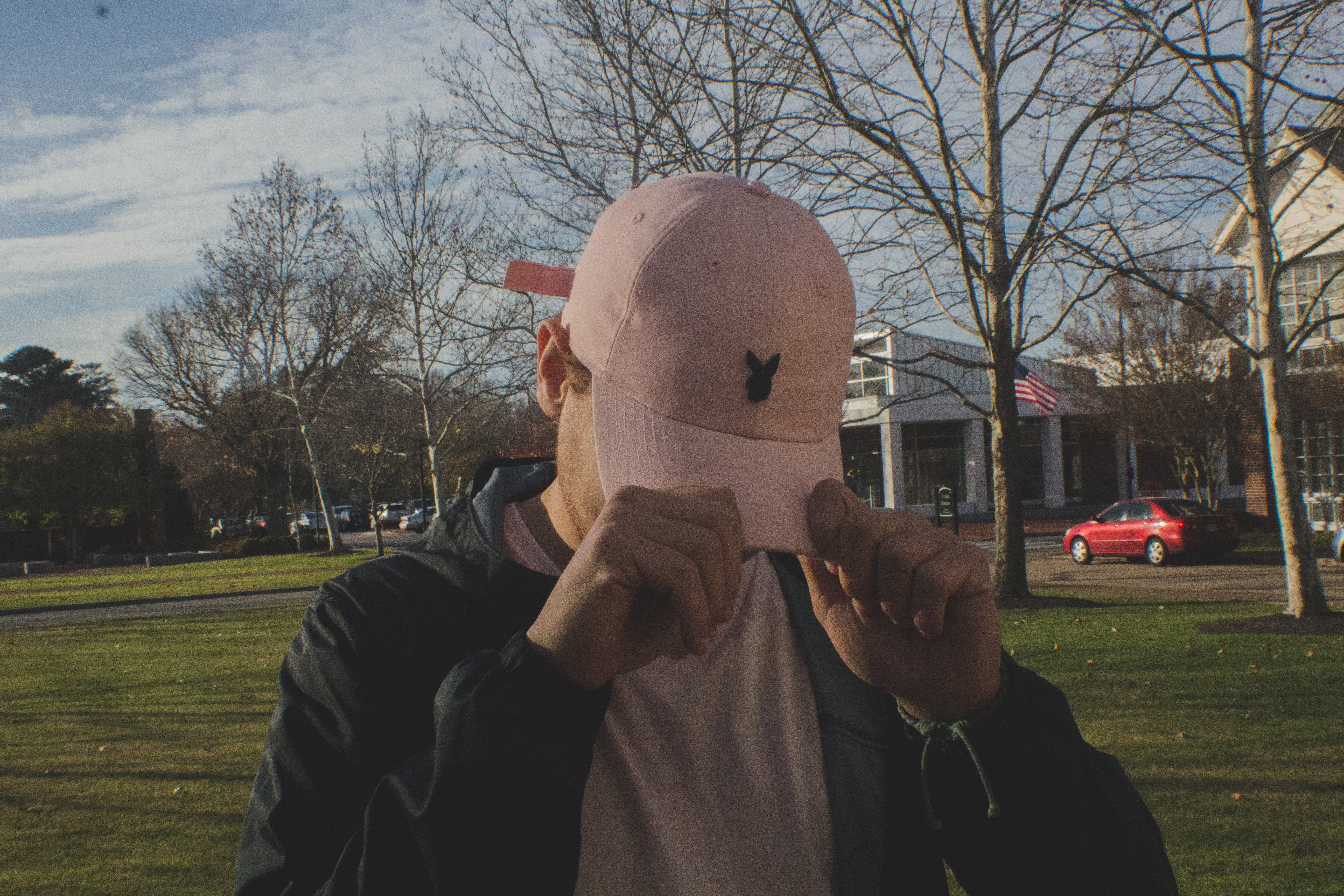 Man Holding White Bunny Fitted Cap