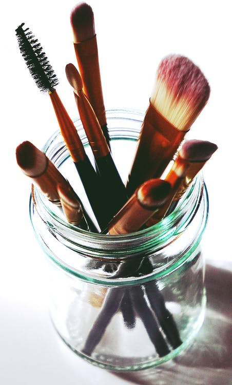 Brown Makeup Brushes in Clear Glass Mason Jar