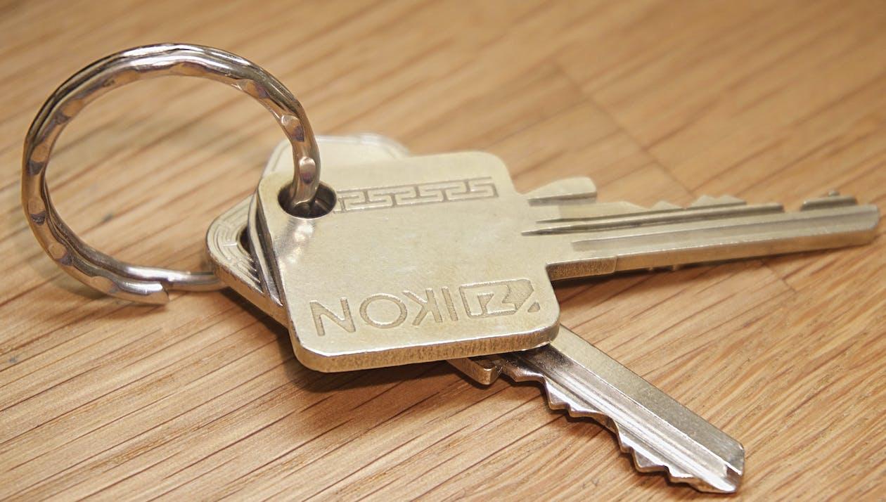 Gray Ikon Keys on Brown Wooden Surface