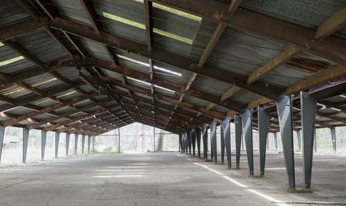 Free stock photo of abandoned building, overgrown, rust, steel