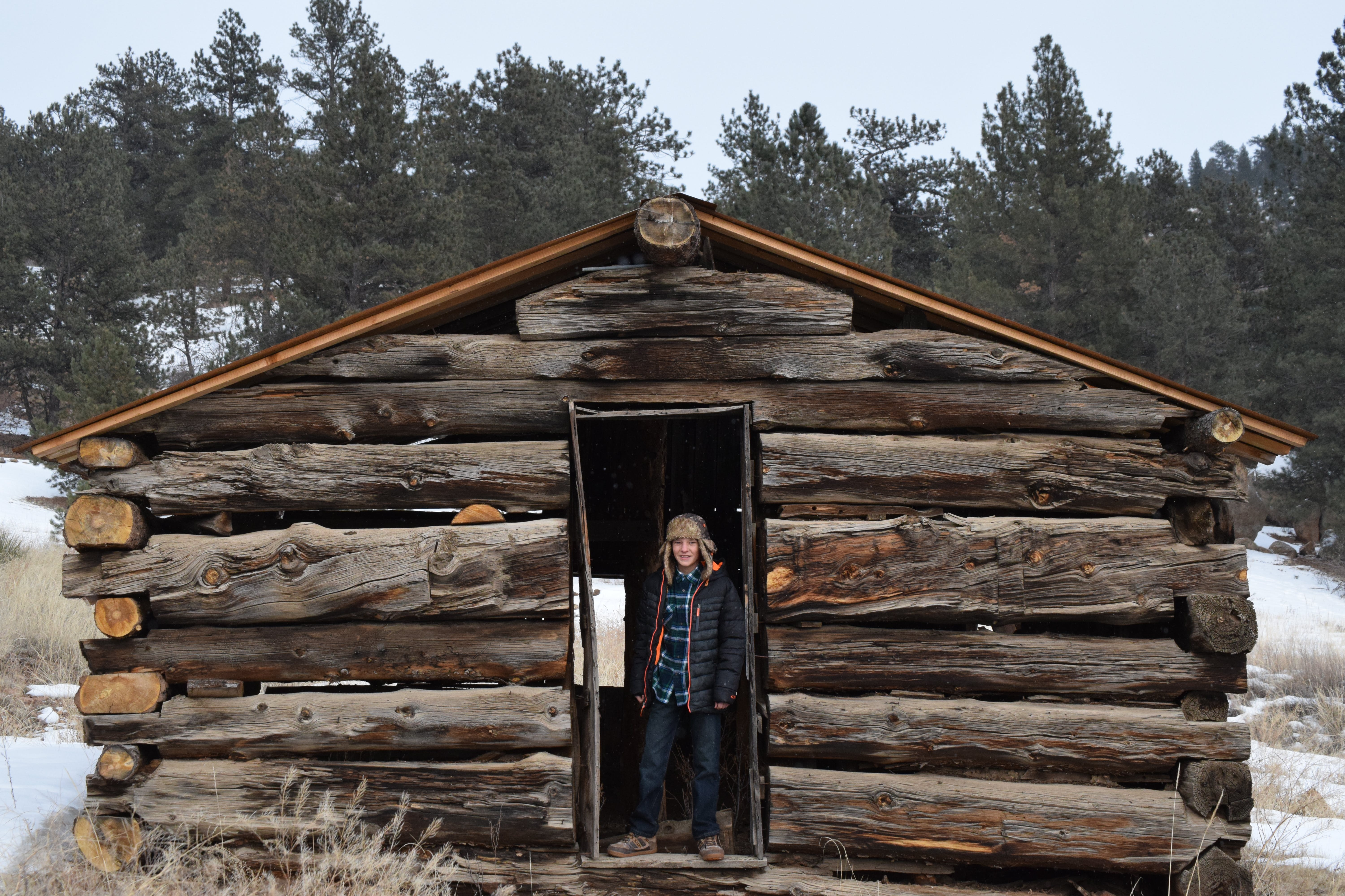 Person Standing in Front of Barn House