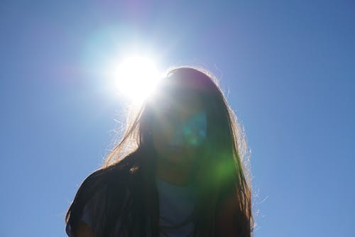Woman Takes Photo Under the Sun