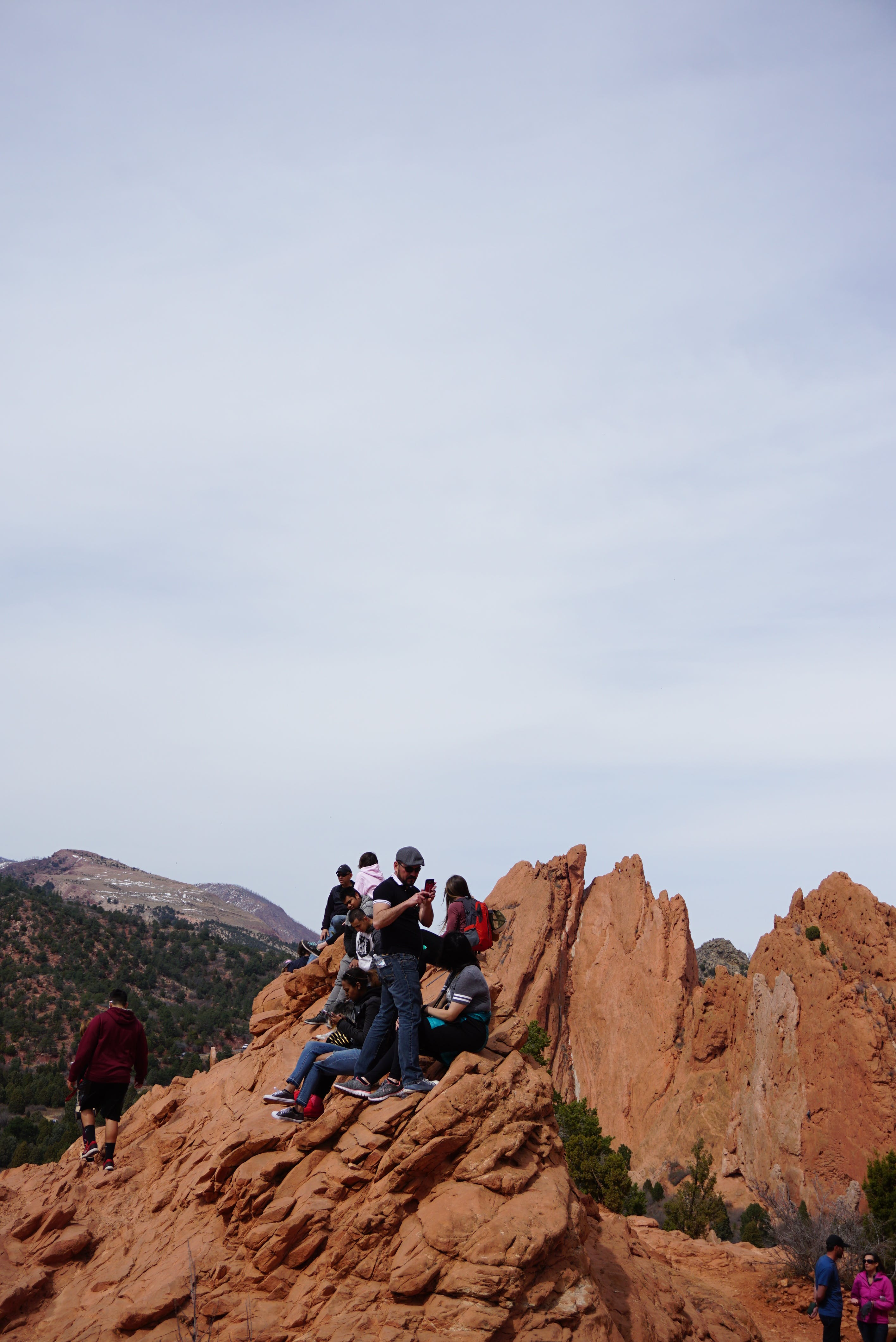 People on Brown Rock Formation