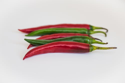 Two Green and Three Red Chili Peppers