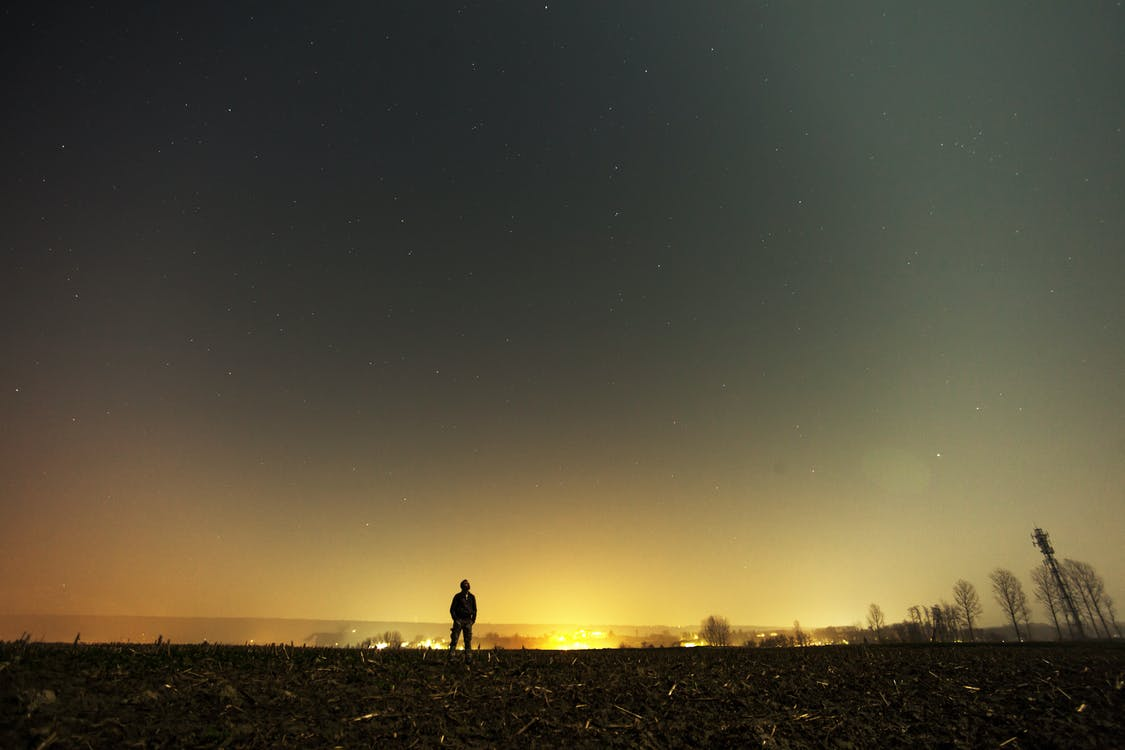 Silhouette of Standing Man during Golden Hour