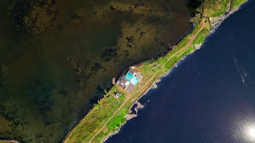 Satellite View of Land Beside Body of Water
