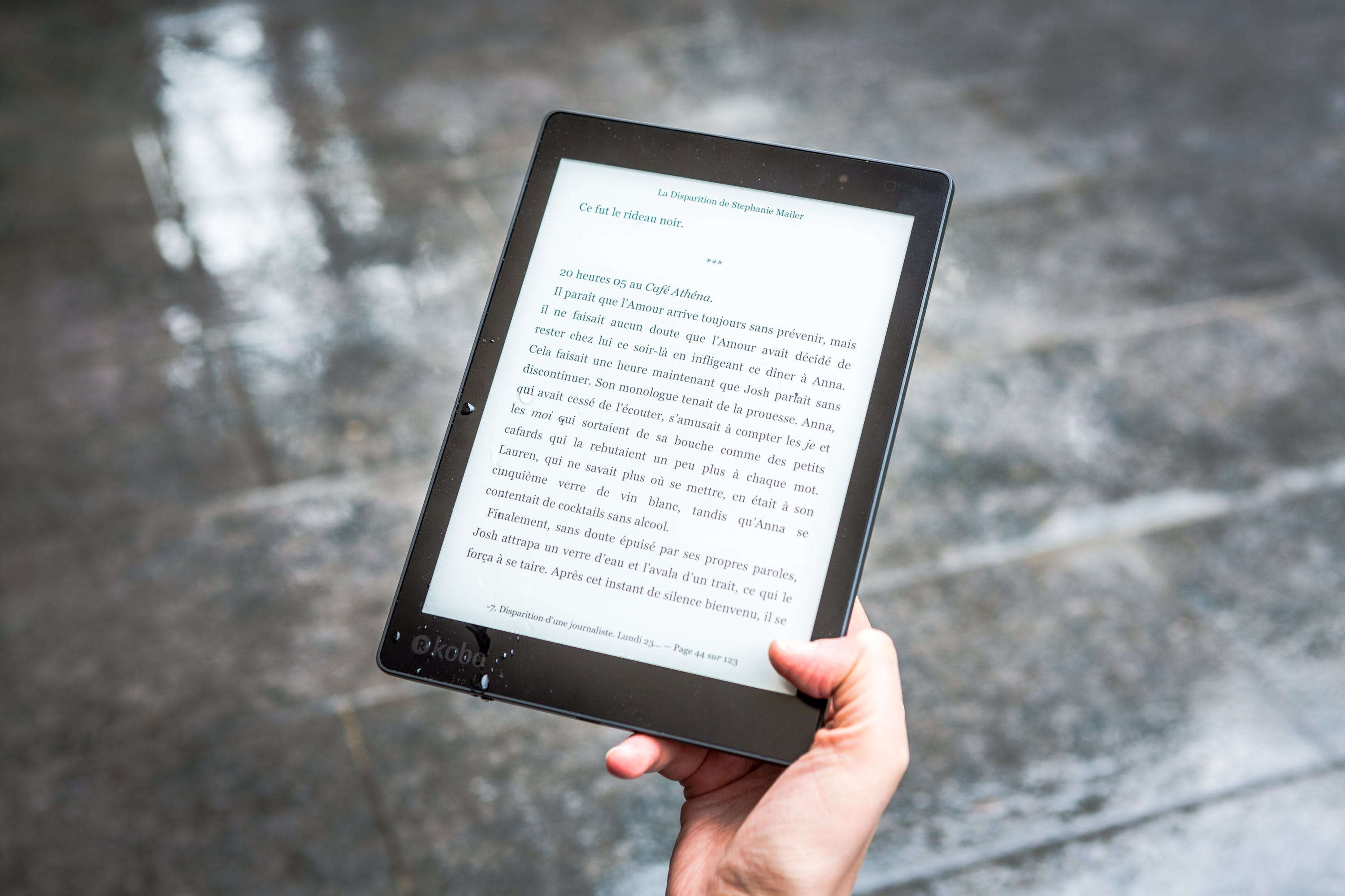Person Holding Black E-book Reader