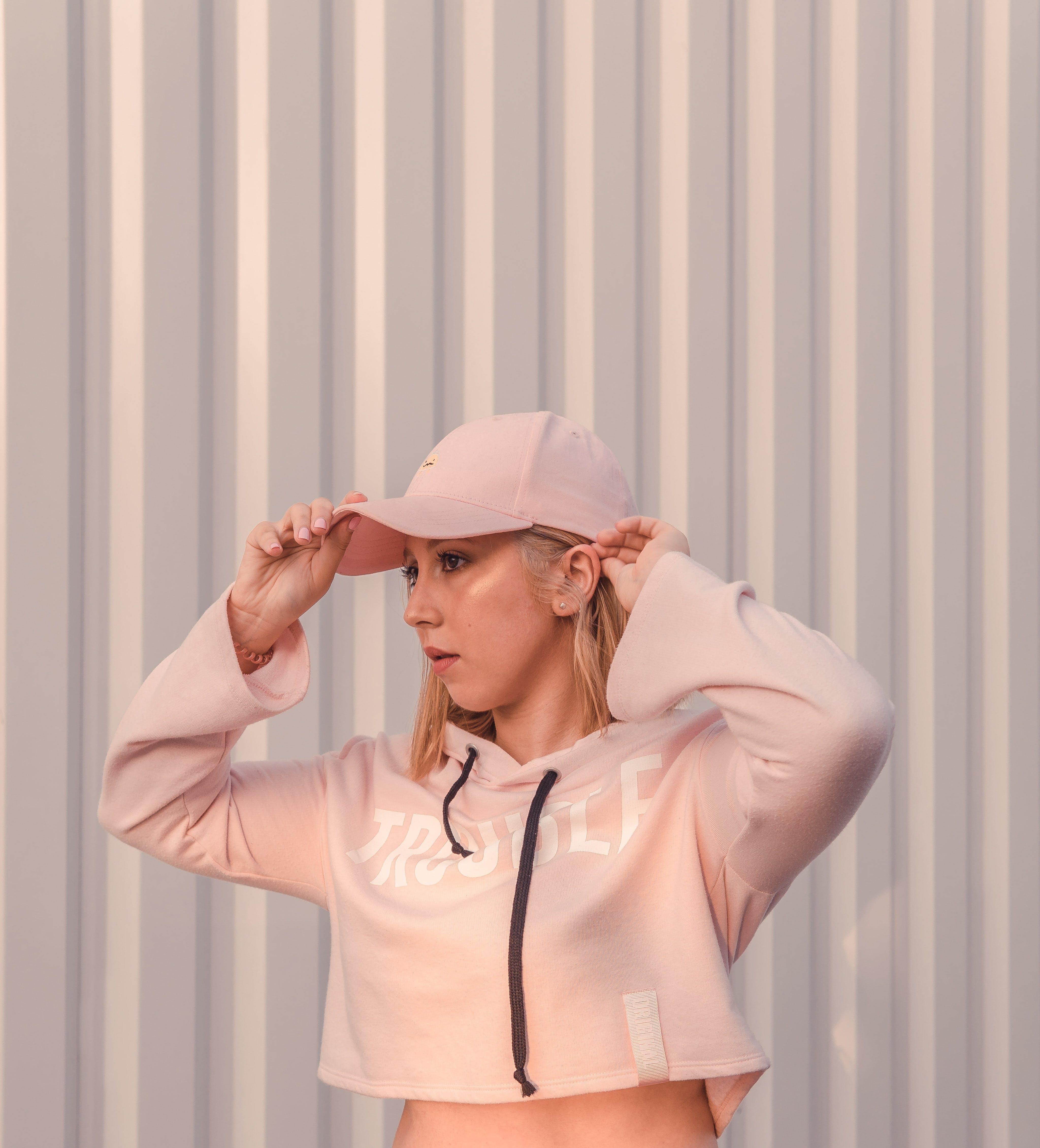 Photo of Woman Wearing Pink Crop Top