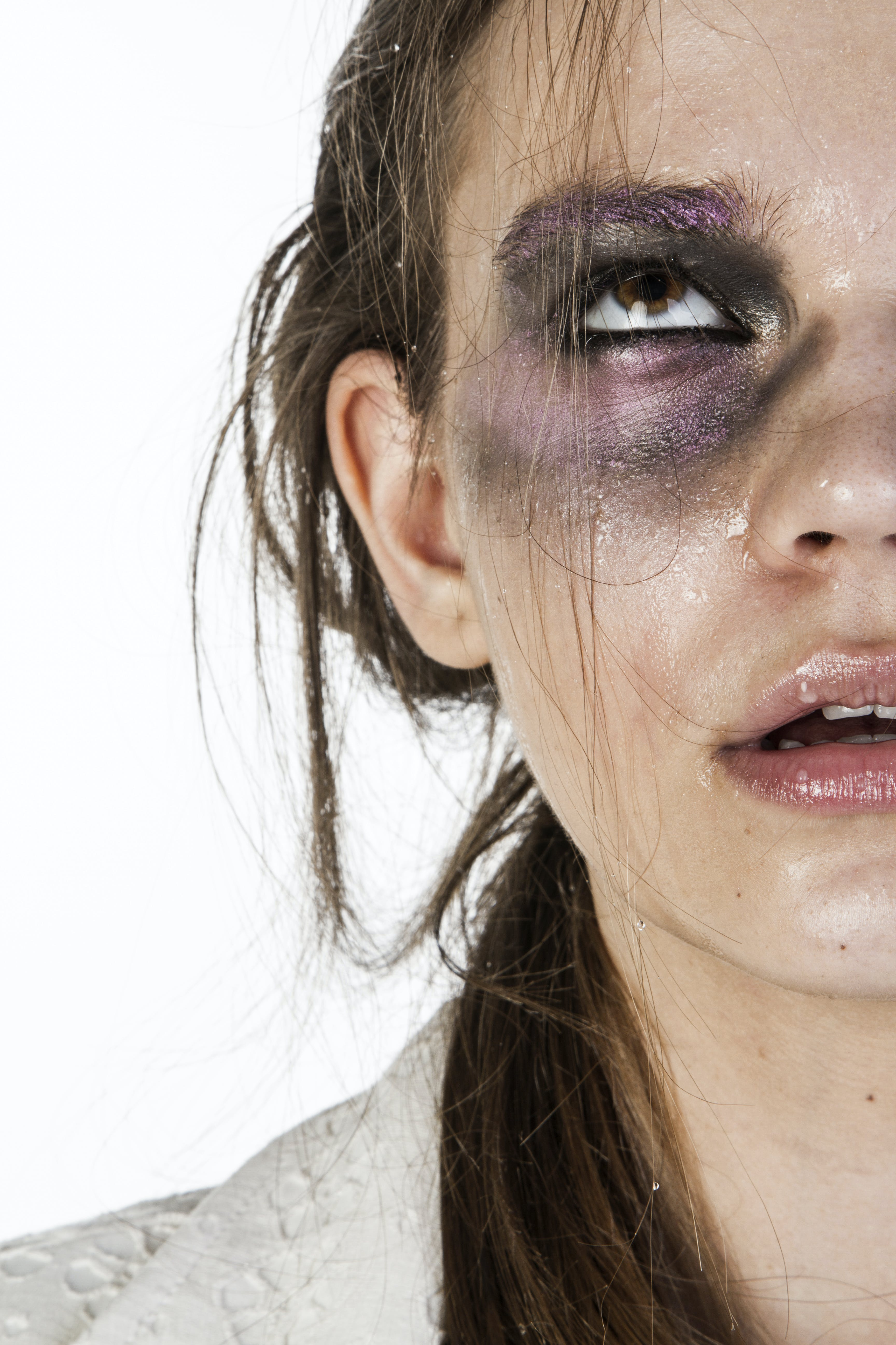 Close-Up Photo of Woman With Black and Purple Eye Shadow